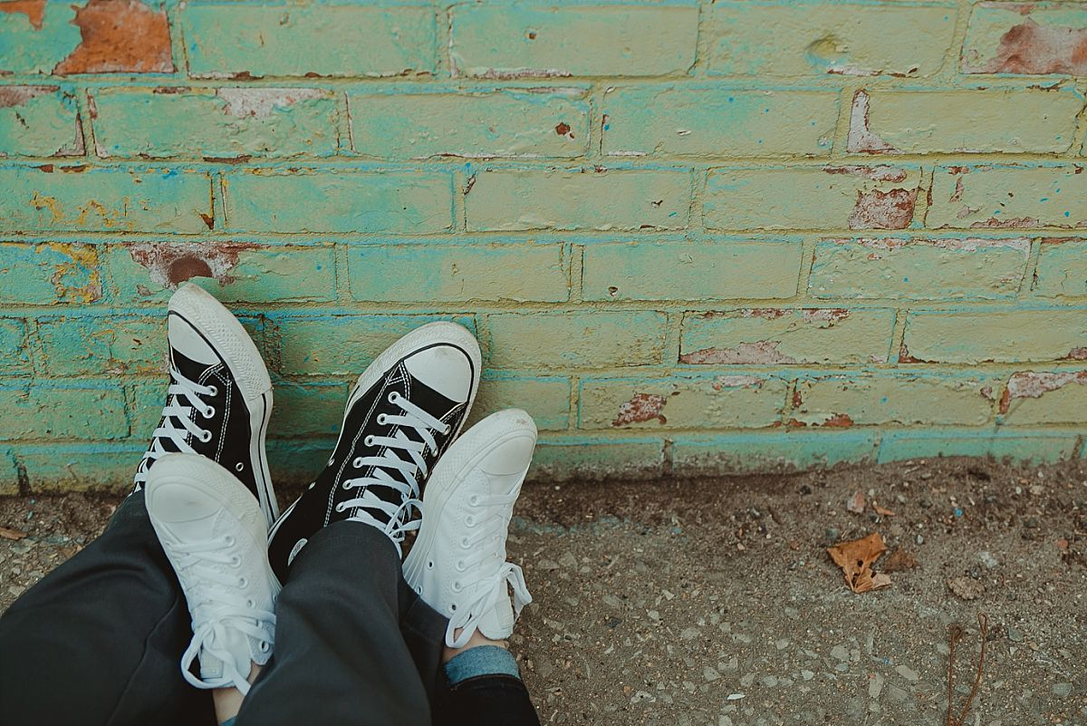 photo of couples sneakers in front of colorful graffiti mural in brooklyn. photo by nyc family photographer krystil mcdowall