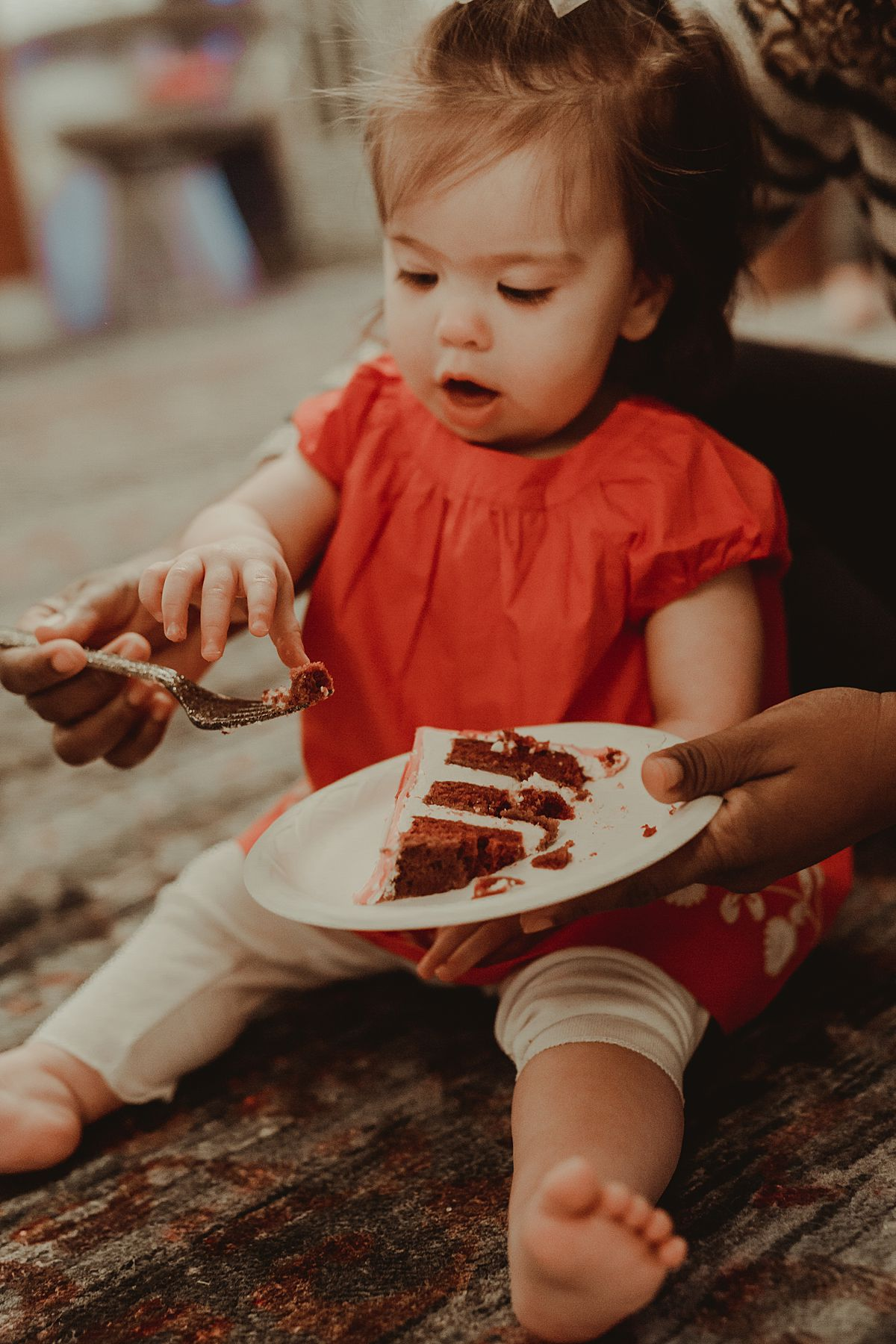 photo of daughter eating her one year birthday cake. photo by nyc family and newborn photographer Krystil McDowall