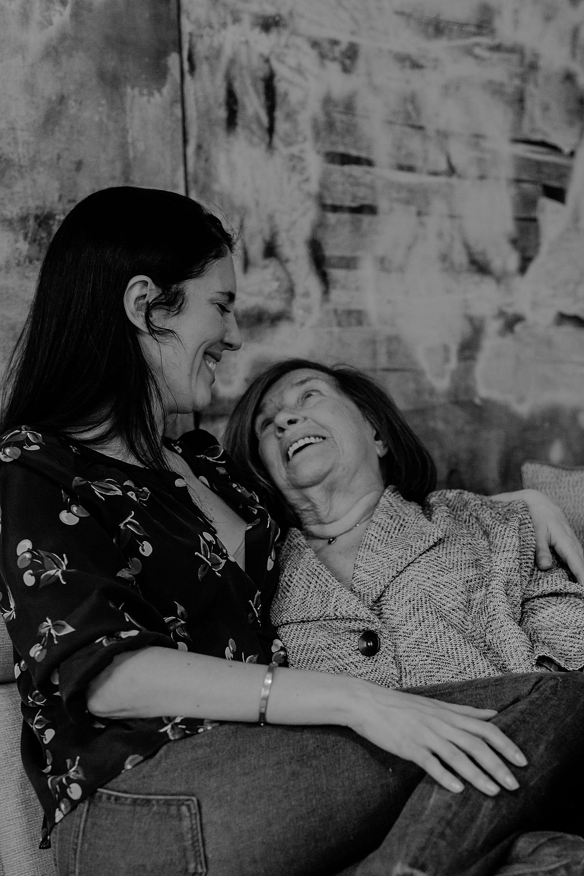 candid portrait of mother and grandmother enjoying laughs together. photo by nyc family and newborn photographer Krystil McDowall