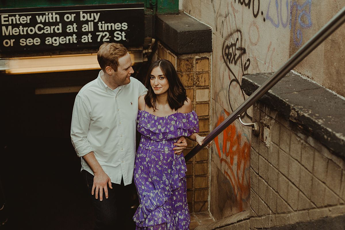 portrait of expecting couple leaving subway station at west 72nd street just off of central park west nyc. maternity photo by nyc family and newborn photographer krystil mcdowall