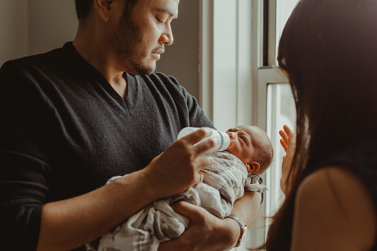 Candid image taken during one of my in home lifestyle newborn photo sessions