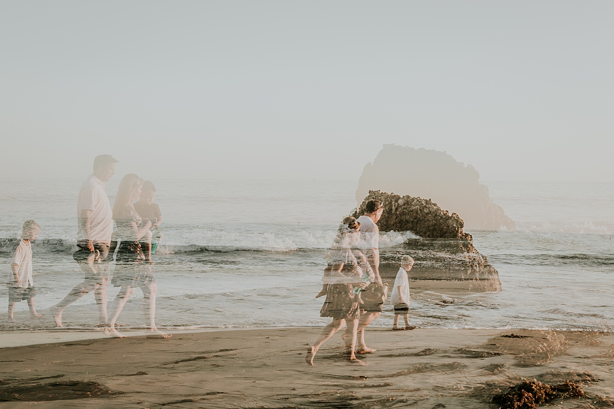 orange county family photographer. double exposure photo of family as they walk along Corona del Mar State Beach with Krystil McDowall Photography