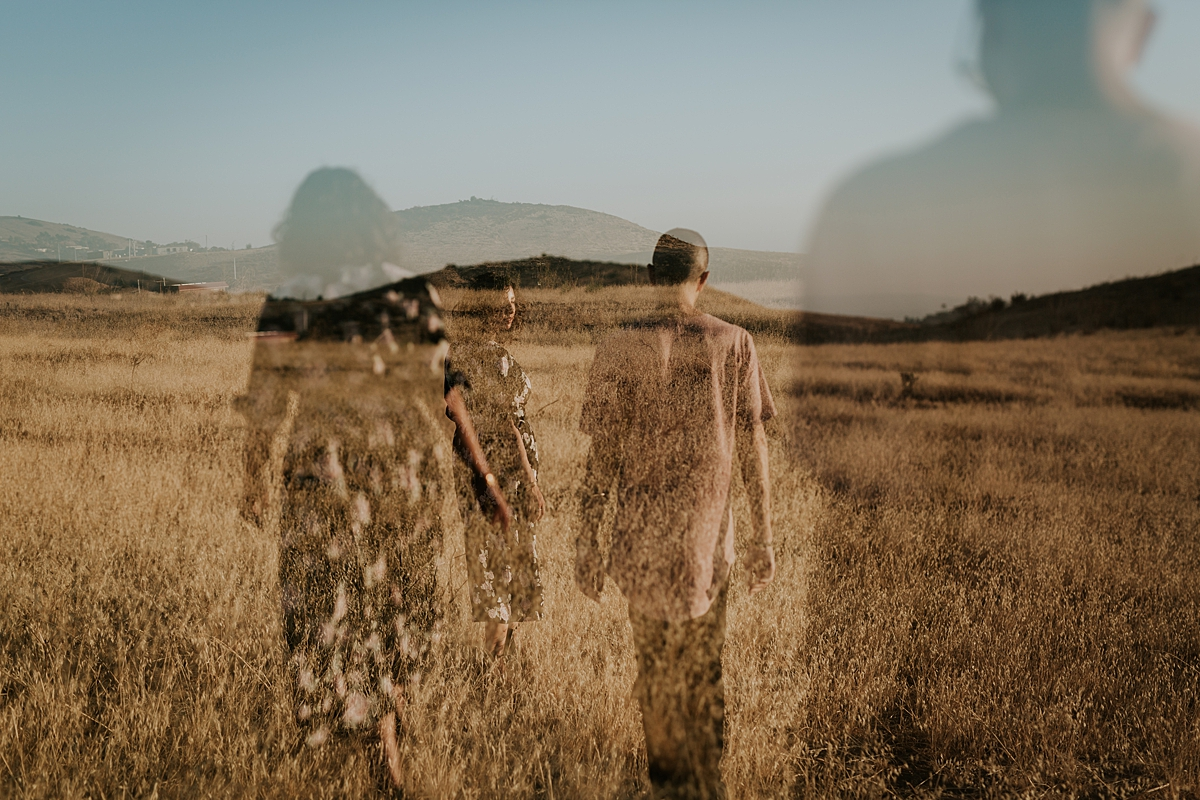 Orange County family photographer. double exposure photo of married couple standing in the fields at sunset during couple's photo session at Irvine Regional Park