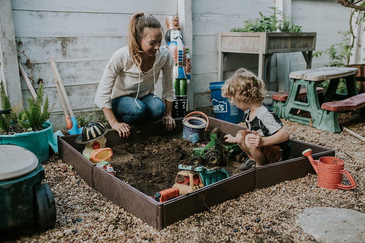 Orange County family photographer. Photo of mother and son gardening in their front yard during documentary photo session with Krystil McDowall Photography
