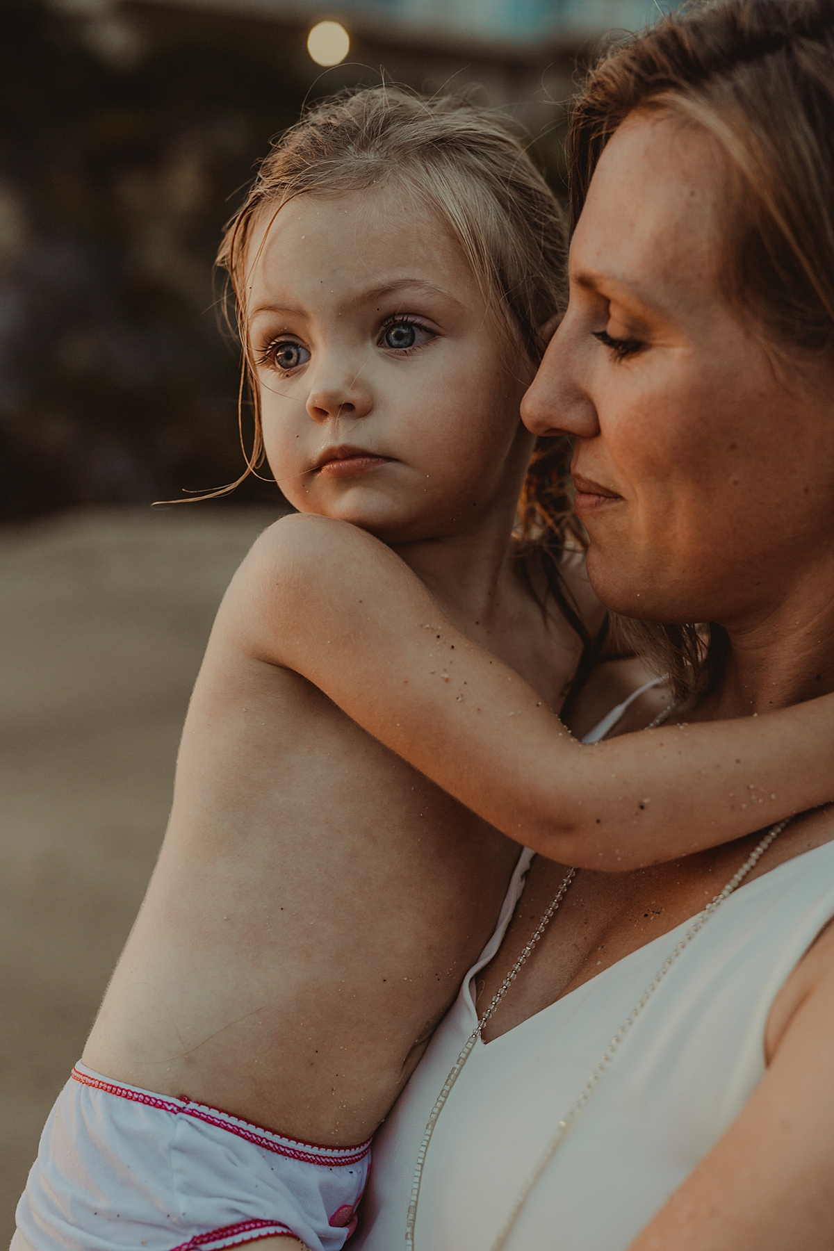 Orange County family photographer. Portrait of mom and daughter at sunset at Table Rock Beach Laguna Beach during photo session with Krystil McDowall Photography