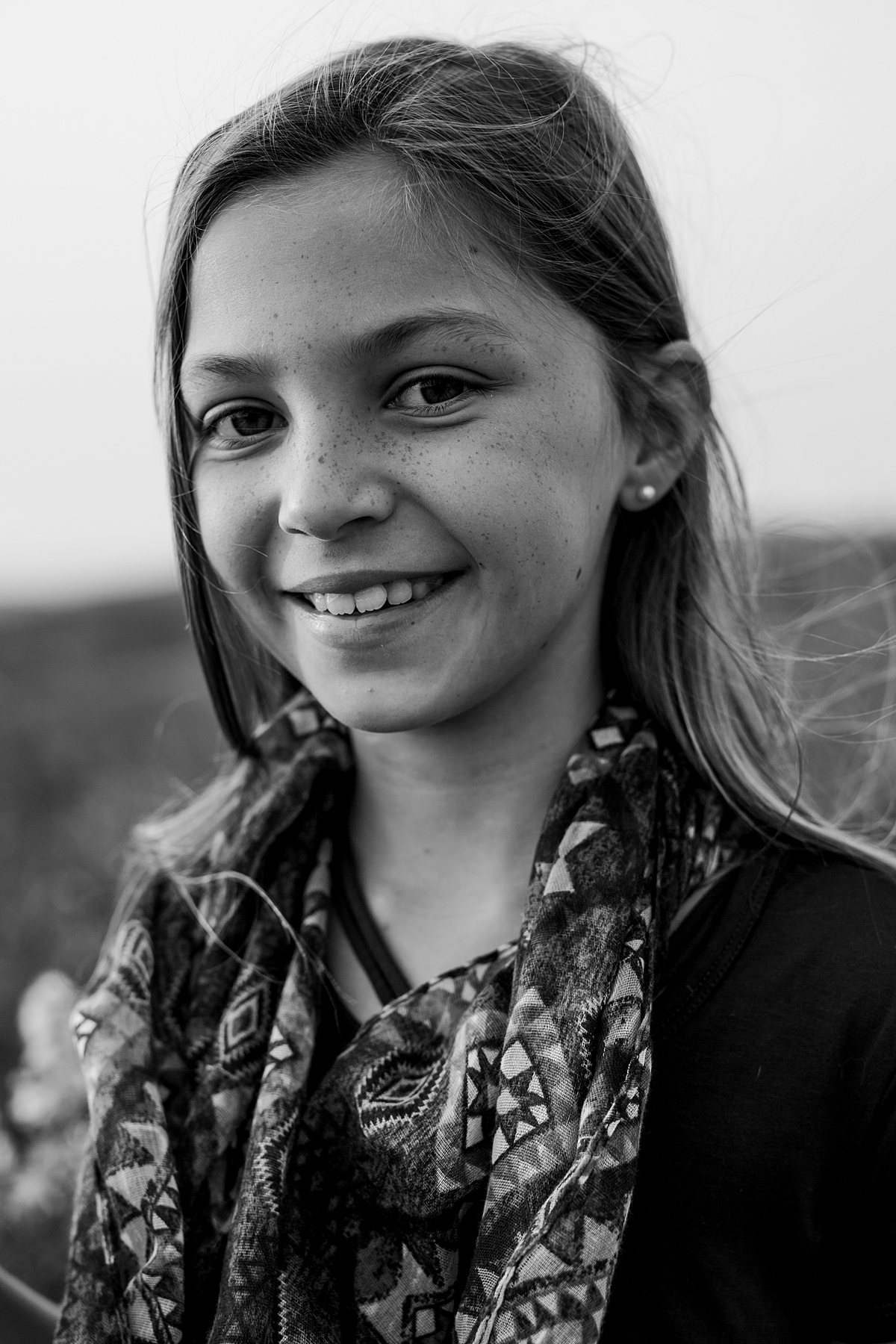 Orange County family photographer. Black and white portrait of youngest daughter at Top of the World Laguna Beach