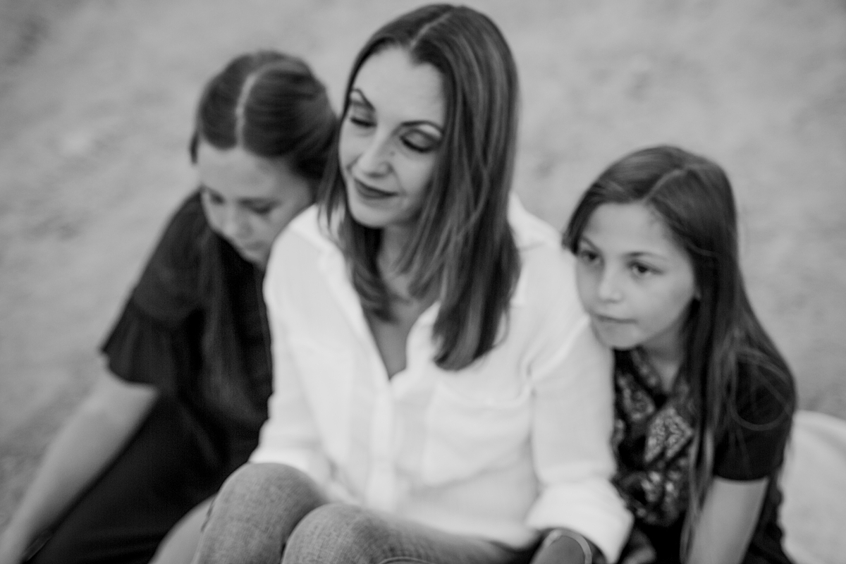 Orange County family photographer. Portrait of mom and her daughters at Top of the World Laguna Beach by Krystil McDowall Photography
