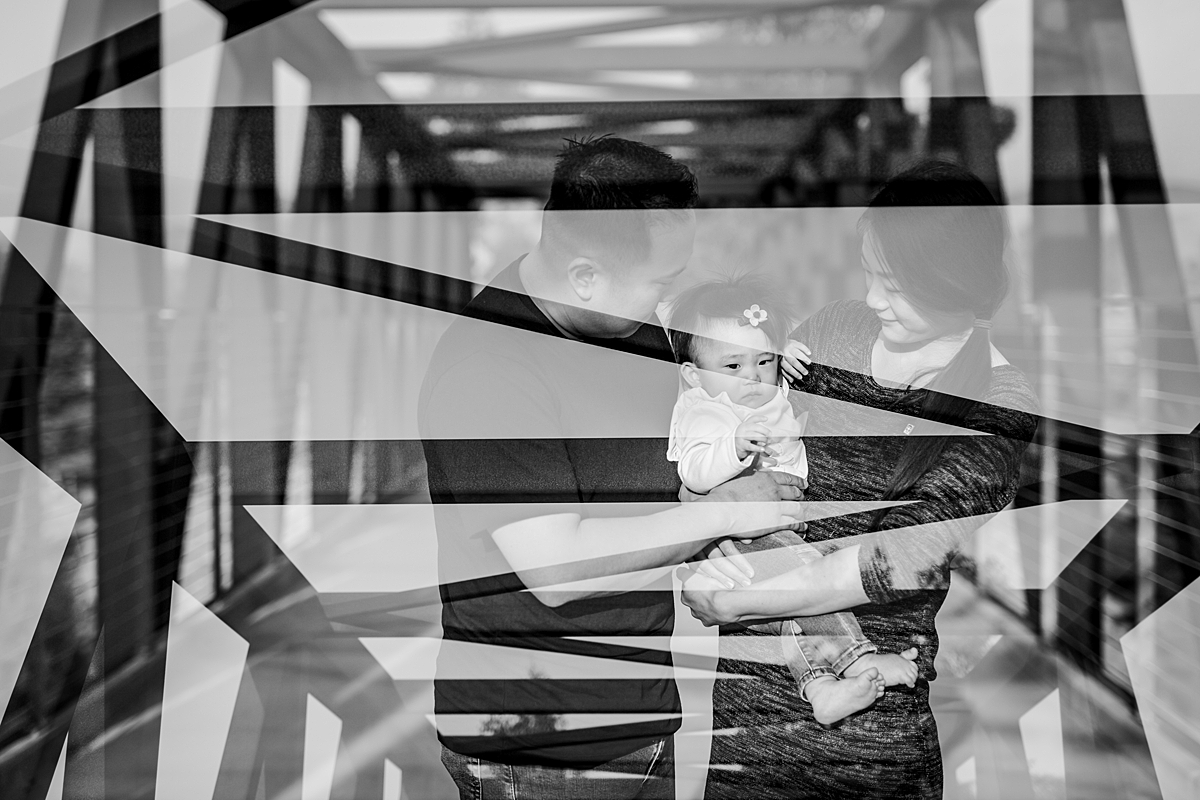 Orange County family photographer. Double exposure photo of mom, dad and sweet one year old daughter standing on bridge during outdoor family photo session at Jeffrey Open Space Trail in Irvine