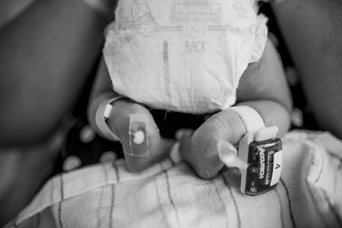 Orange County family photographer. Photo of teeny legs of two day old newborn baby taken during fresh 48 session with Krystil McDowall Photography