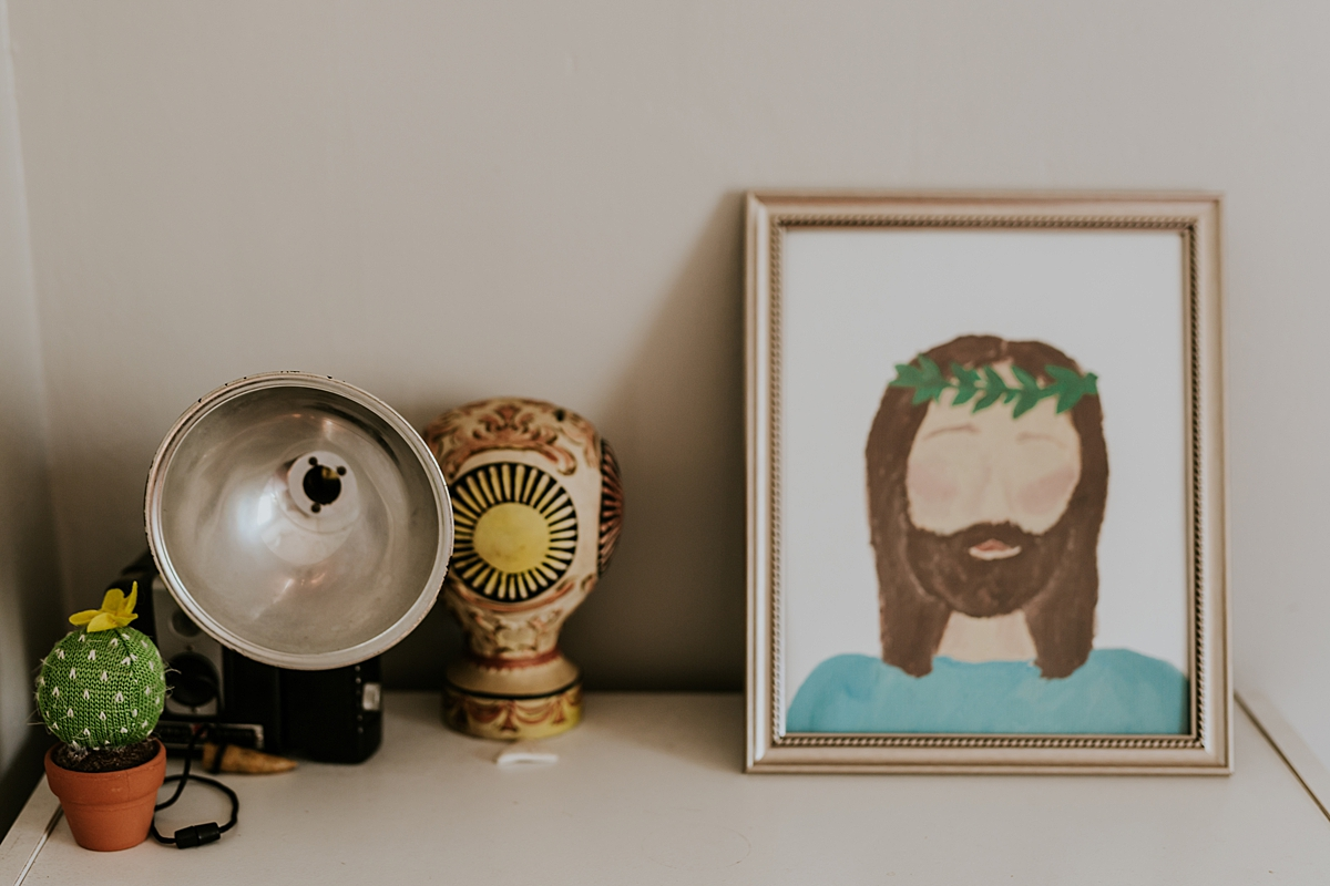 Orange County family photographer. Details photo of cute objects in girl's room including picture of jesus christ taken during in home family photo session in Long Beach, CA