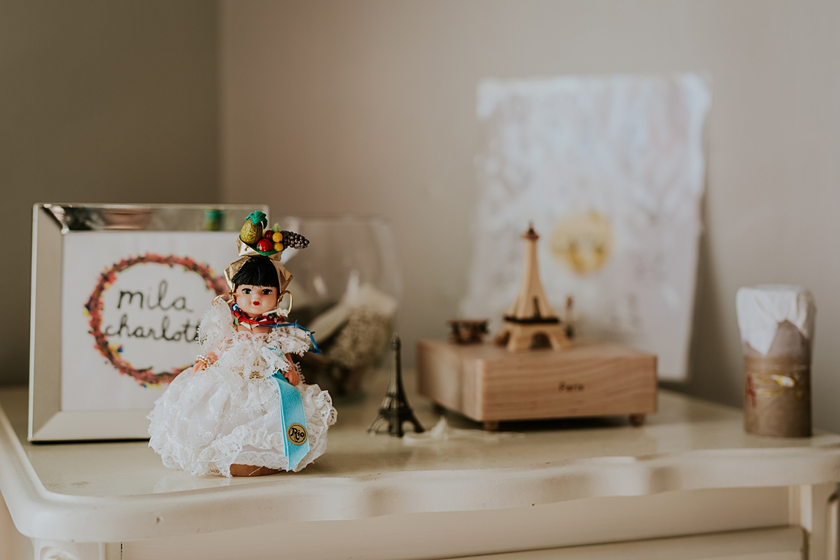 Orange County family photographer. Details photo of cute objects in girl's room including Eiffel Tower statue taken during in home family photo session in Long Beach, CA