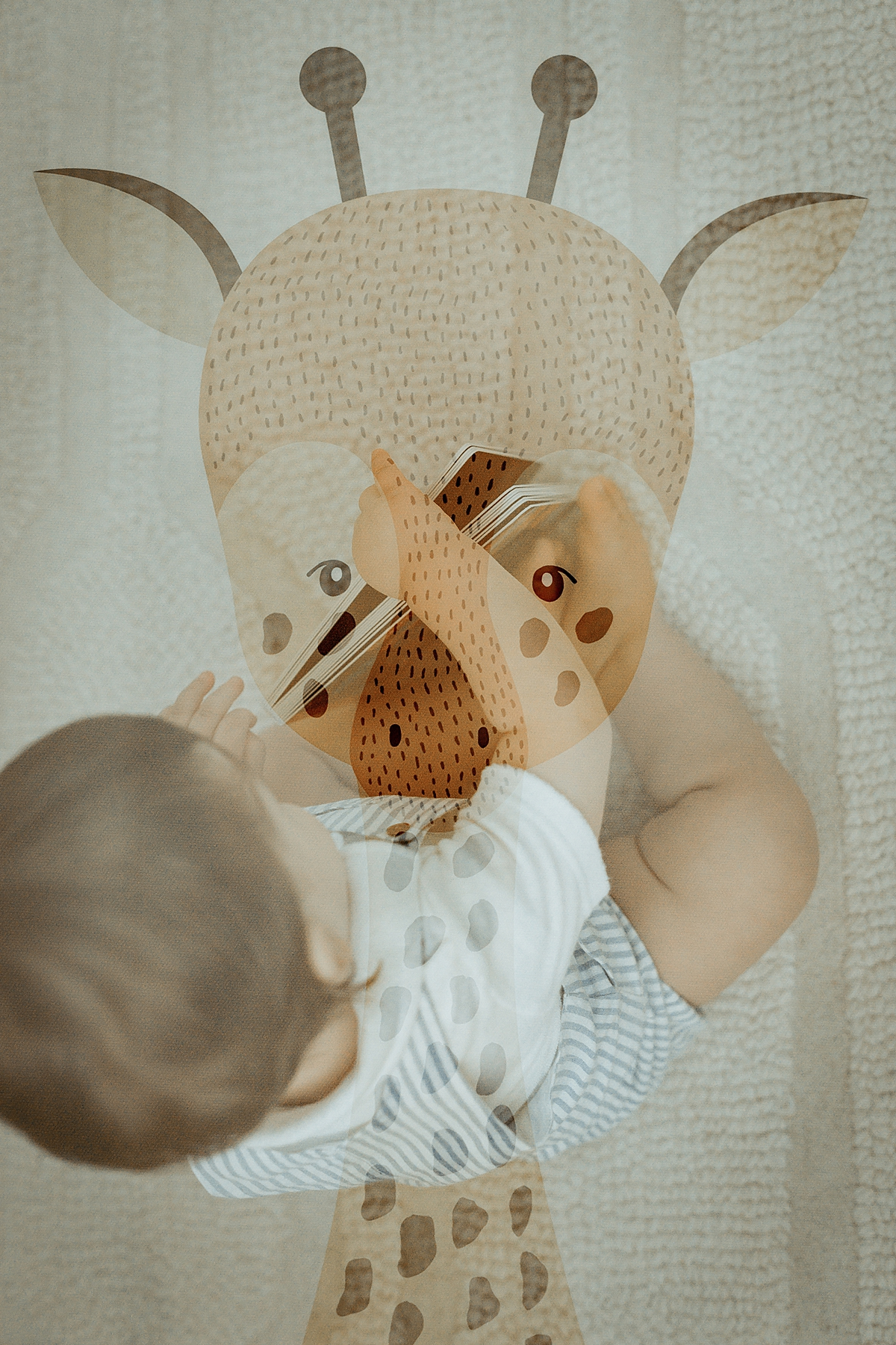 Orange County family photographer. Double exposure photo of one year old boy with his book and giraffe wall hanging taken during in family photo session in Irvine CA