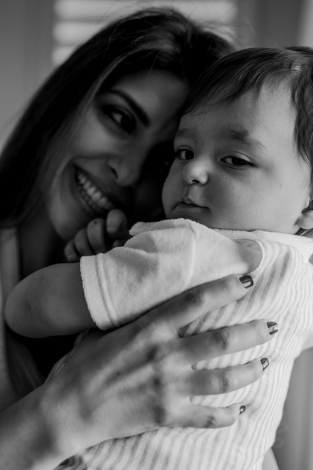 Orange County family photographer. Close up portrait of mom and her son cuddling during in family photo session in Irvine CA