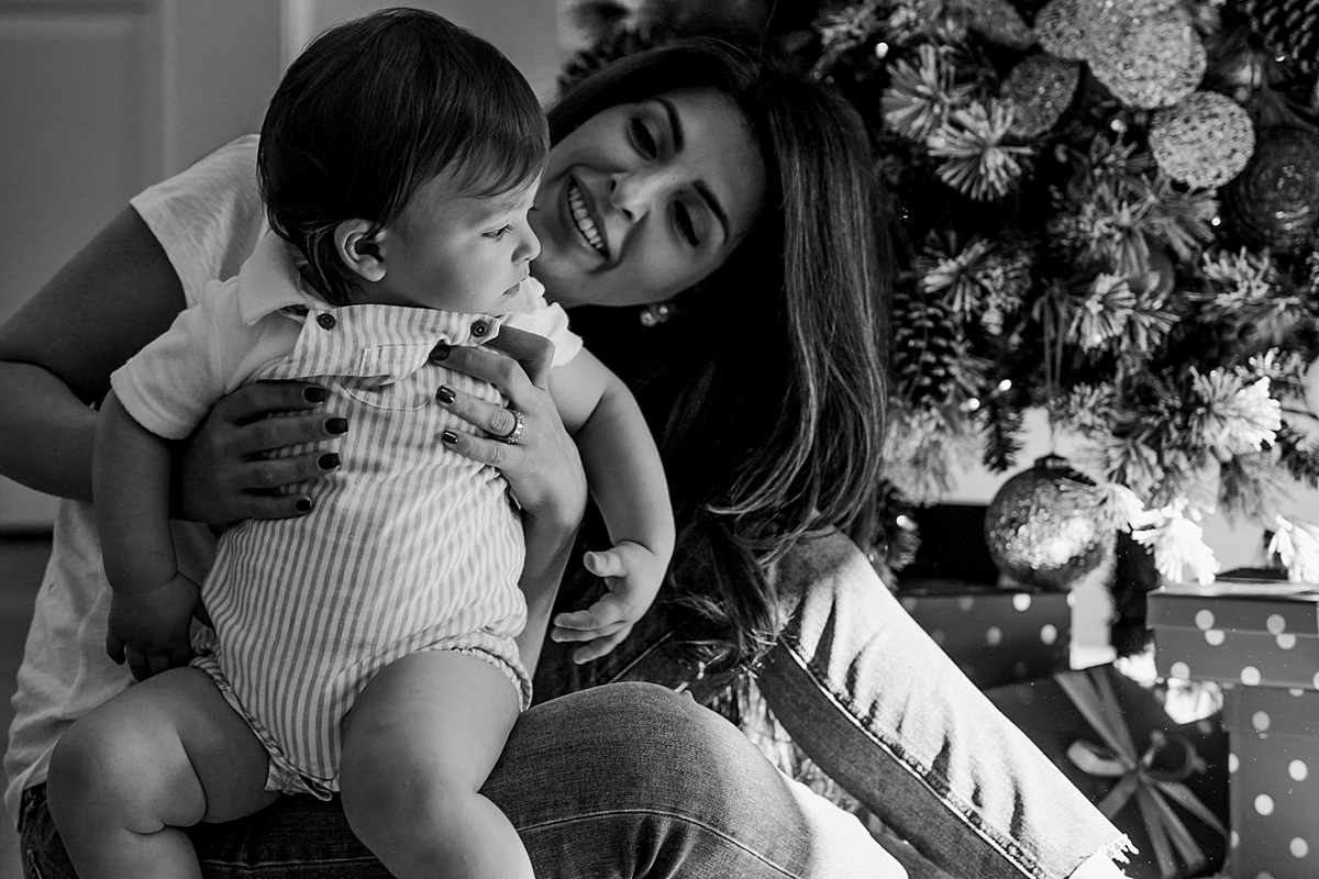 Orange County family photographer. Portrait of mom and her son sitting on the kitchen floor during family photo session in Irvine CA