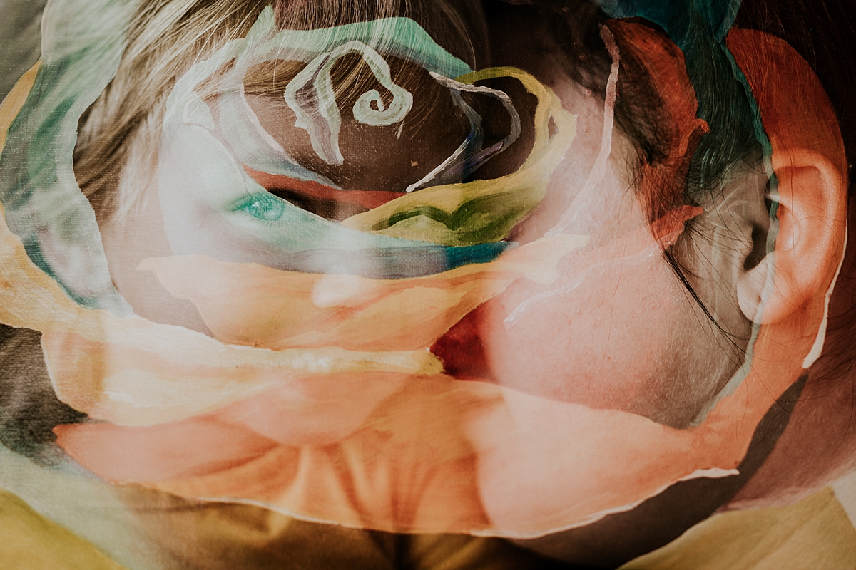 Orange County family photographer. Double exposure photo of colorful wall painting and mom and daughter taken during in home family photo session in Long Beach, CA