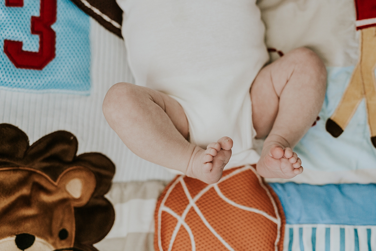 Orange County family photographer. Photo of newborn son's feet taken while he was laying on his personalized boy blanket during newborn photo shoot in Mission Viejo Orange County