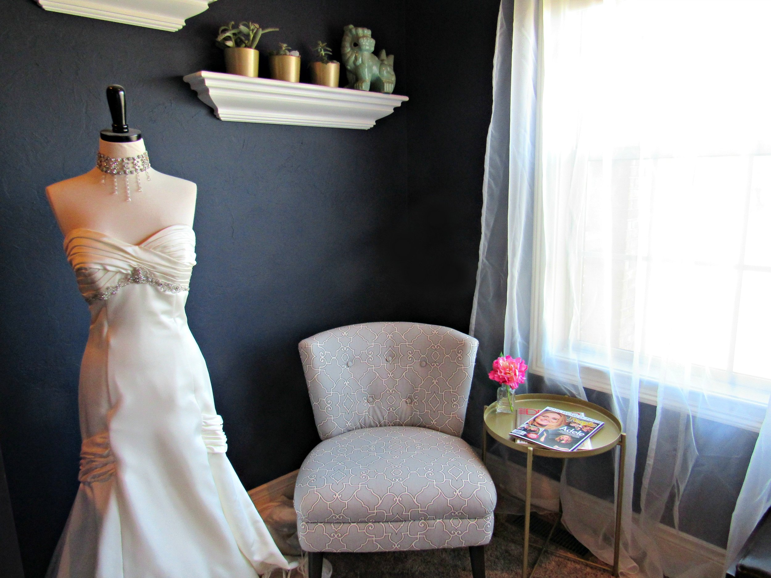 My favorite little corner.  That's my wedding dress on a dress form, and that chair is a DIY upholstery success!