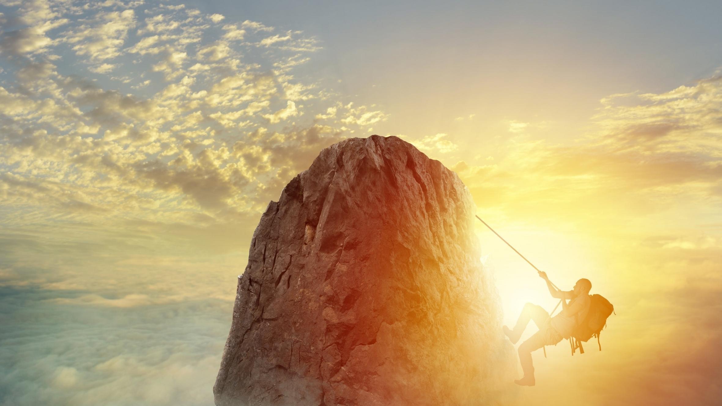 Man climbing mountain.jpg
