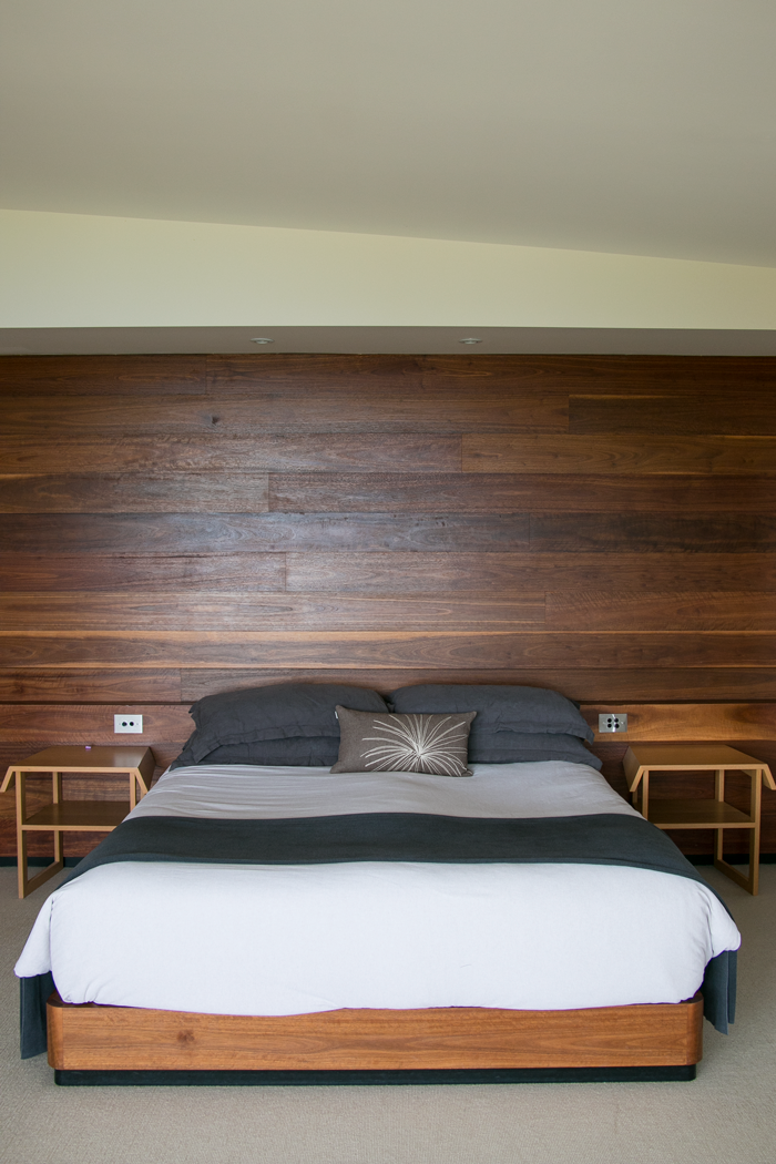 The beautiful bed in our lodge with ocean views