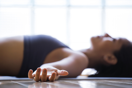 "Shavasana or ""corpse pose"" in yoga is a lying meditation most yoga classes use to integrate the session at the end while cultivating healing & recovery."