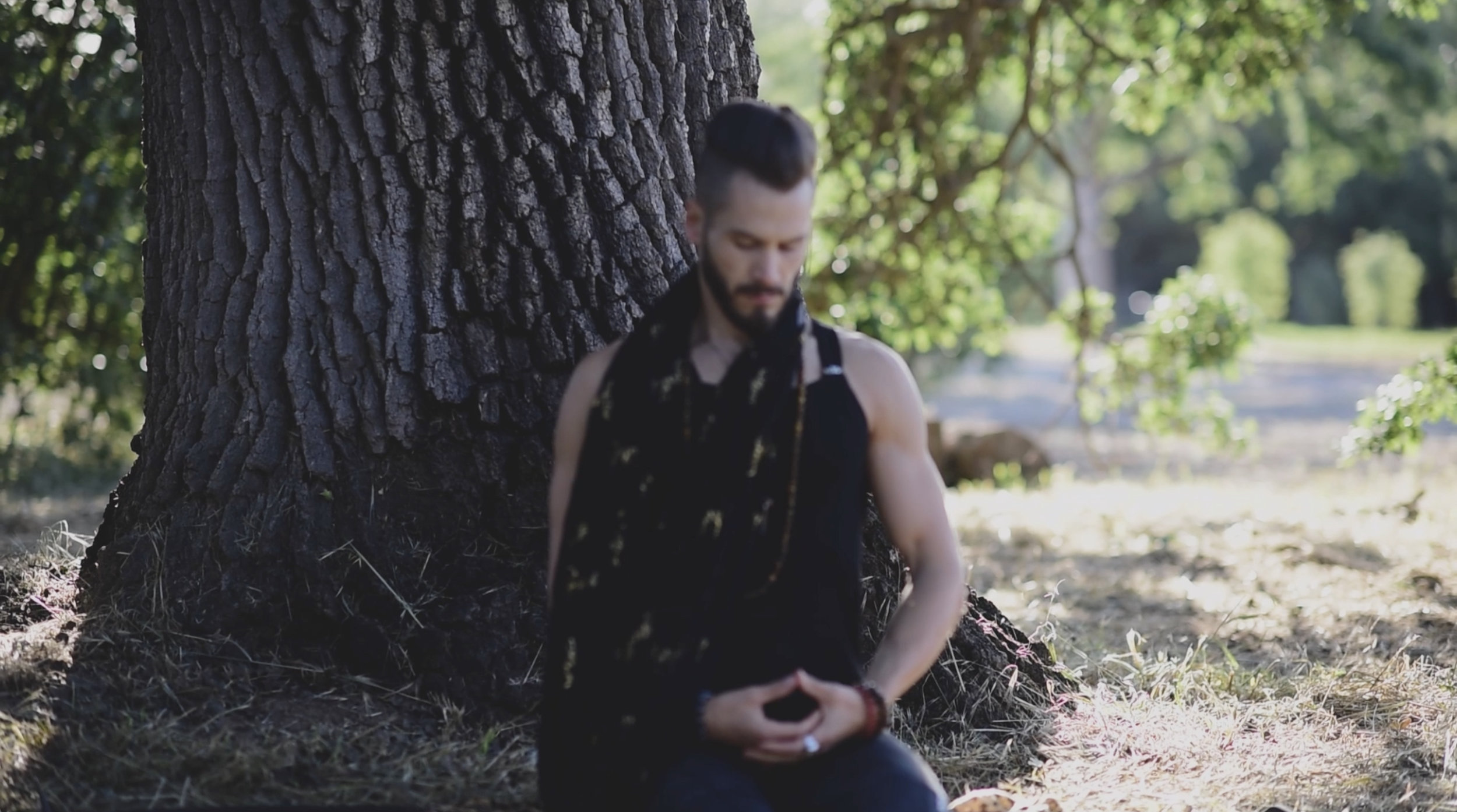 Spiritual hipster incarnate... Seated meditation under a tree harnessing inner wisdom.