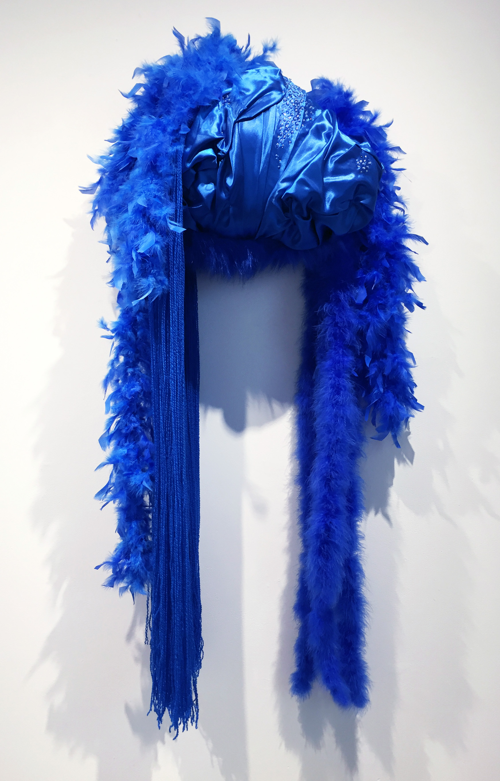 Gwenevere  , 2019   Polystyrene foam, fabrics, feathers, glass beads, sequins and dressmaker pins  56 x 24 x 11 inches