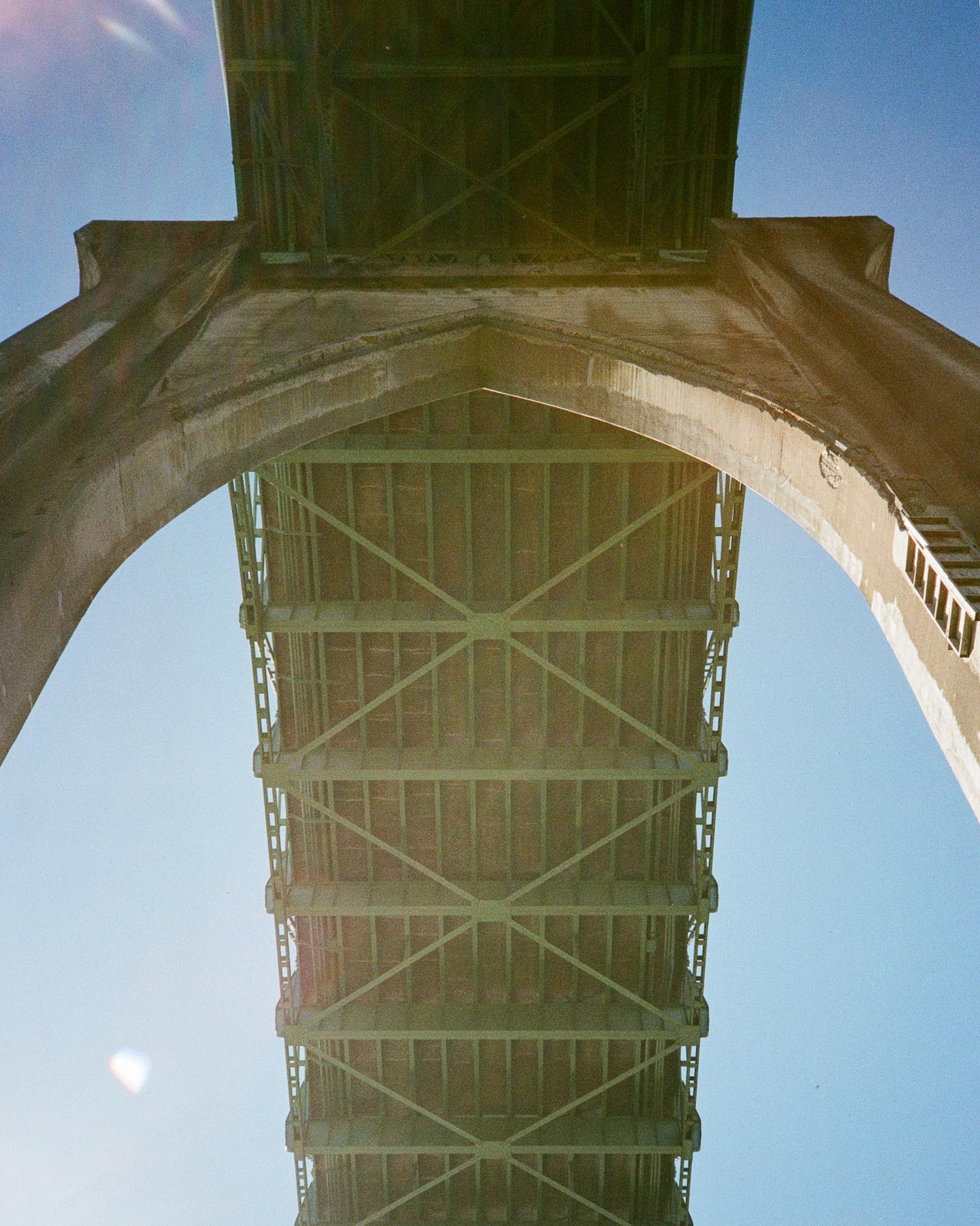 Photo of the underside of St. Johns Bridge from Cathedral Park, Portland, OR