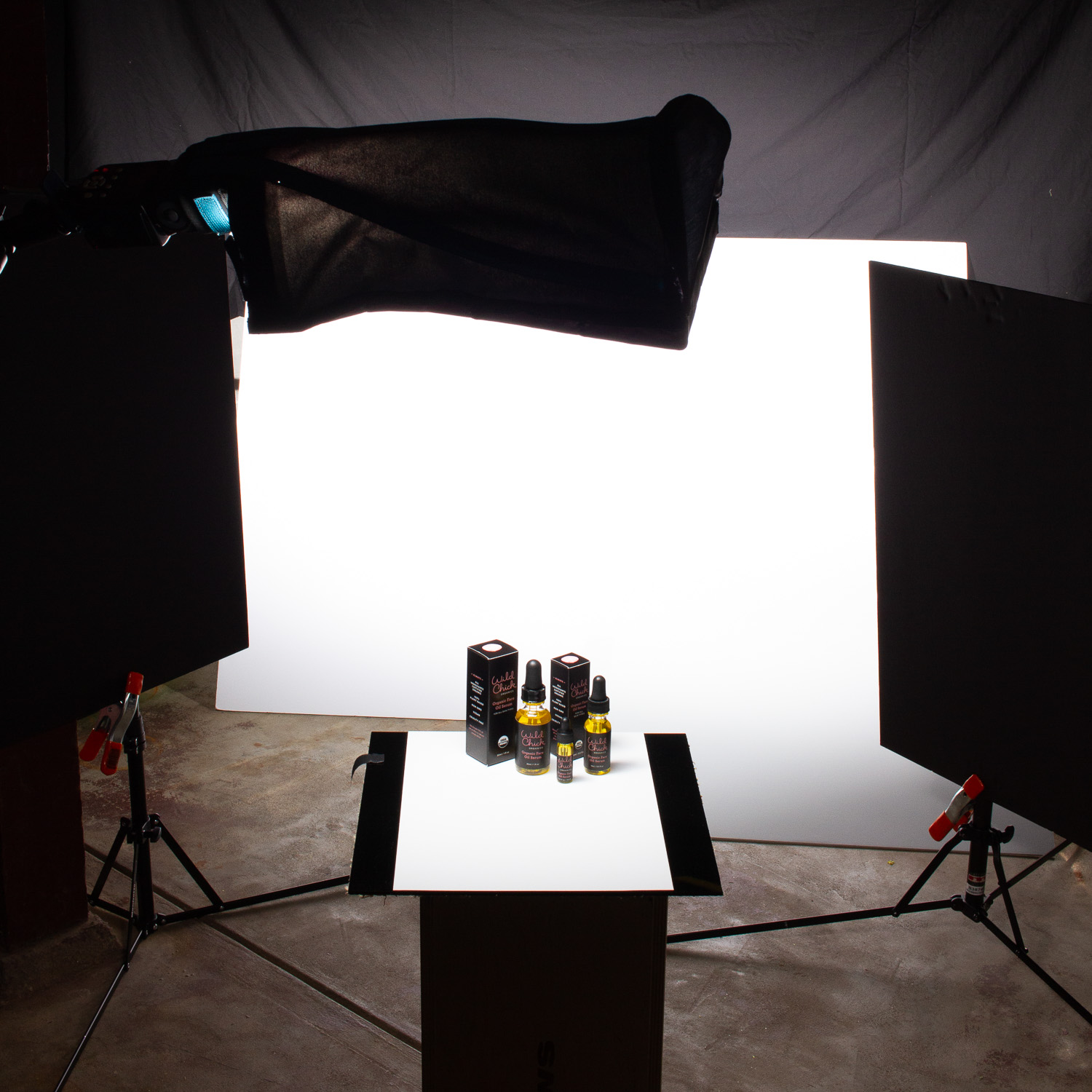 Behind the scenes photo of a white seamless product photo for Wild Chick Organics