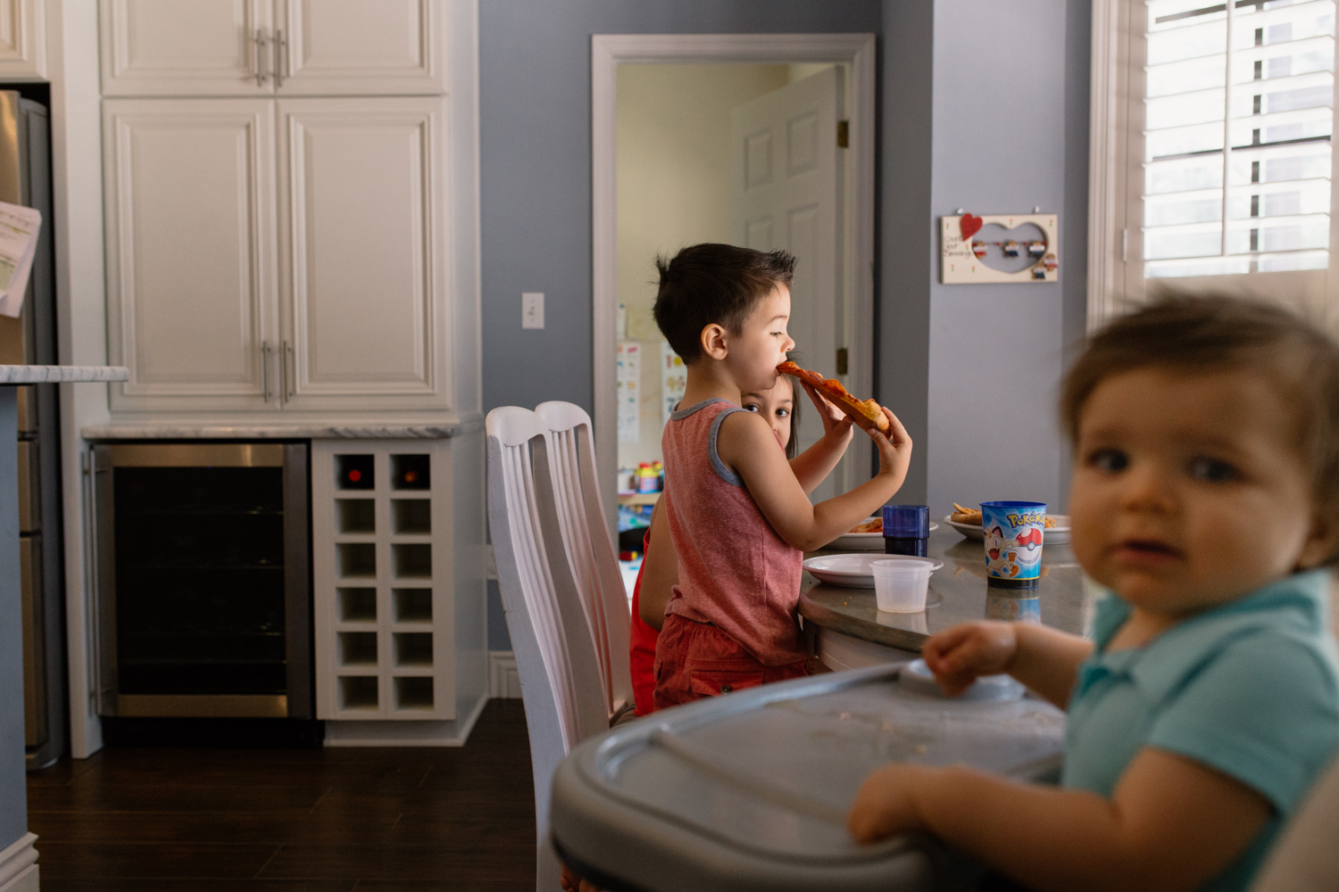 Kids Eating Pizza Orlando Documentary Photographer.jpg