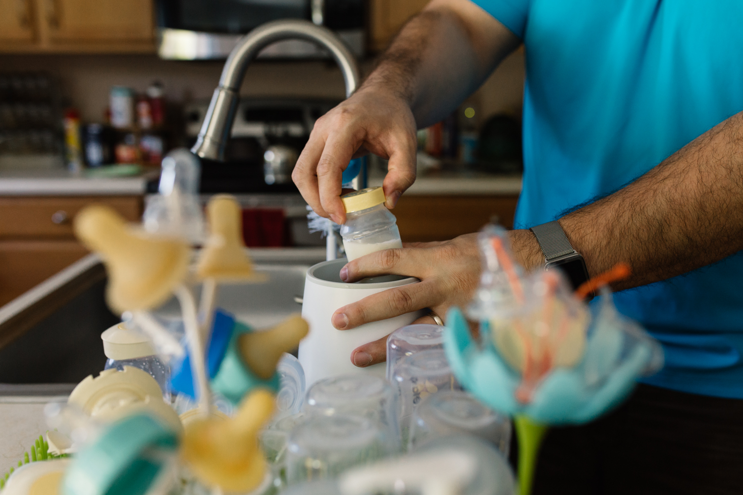 Dad Making Baby Bottle During Orlando FL Lifestyle Newborn Session.jpg