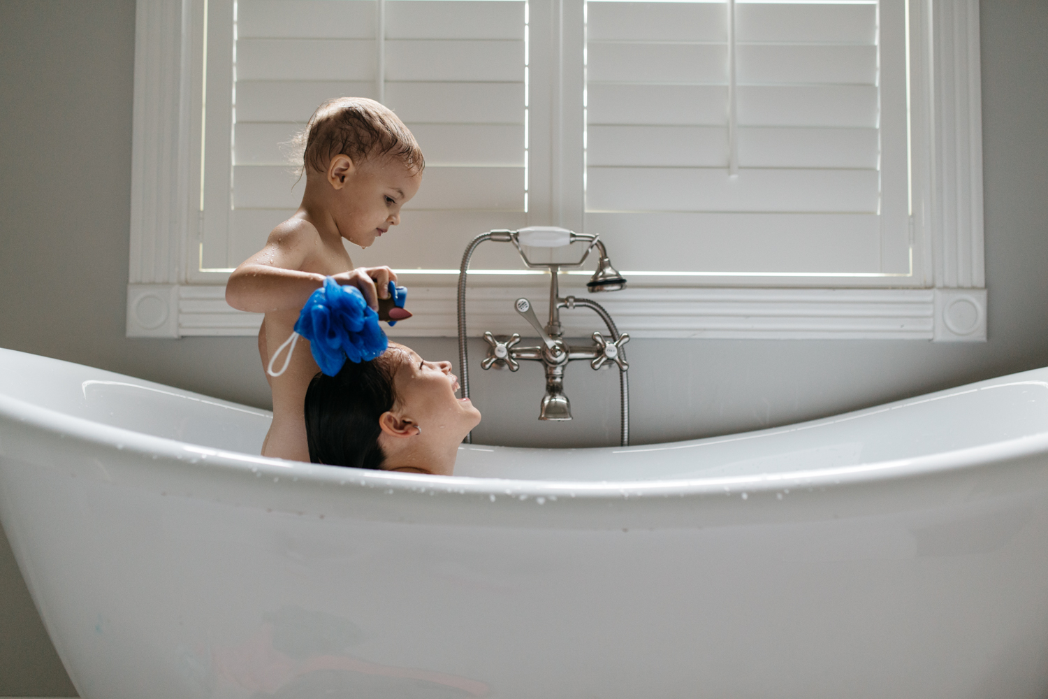 Siblings in Clawfoot Tub Orlando Documentary Photographer.jpg