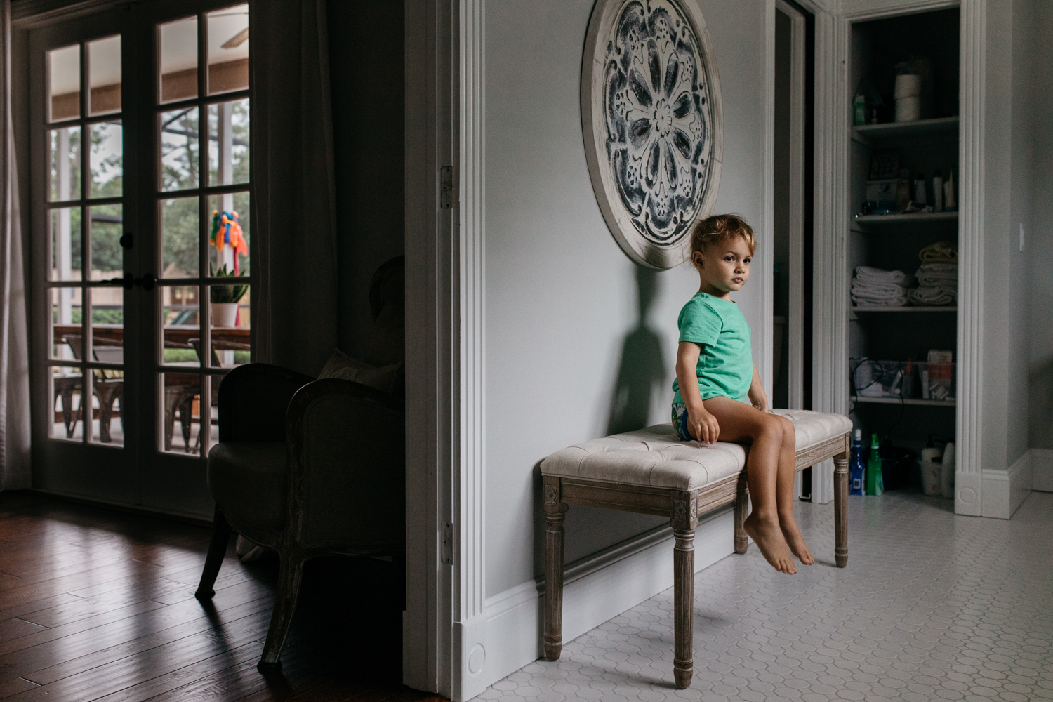 Toddler Boy Sitting on Bench in Bathroom Orlando Lifestyle Photographer