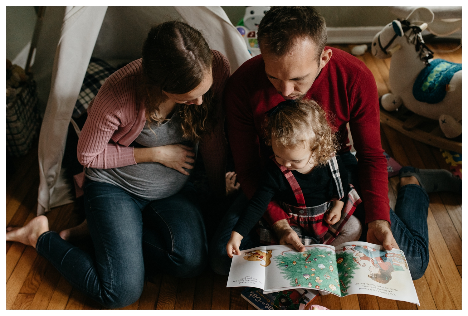 Toddler Reading Book with Parents.jpg