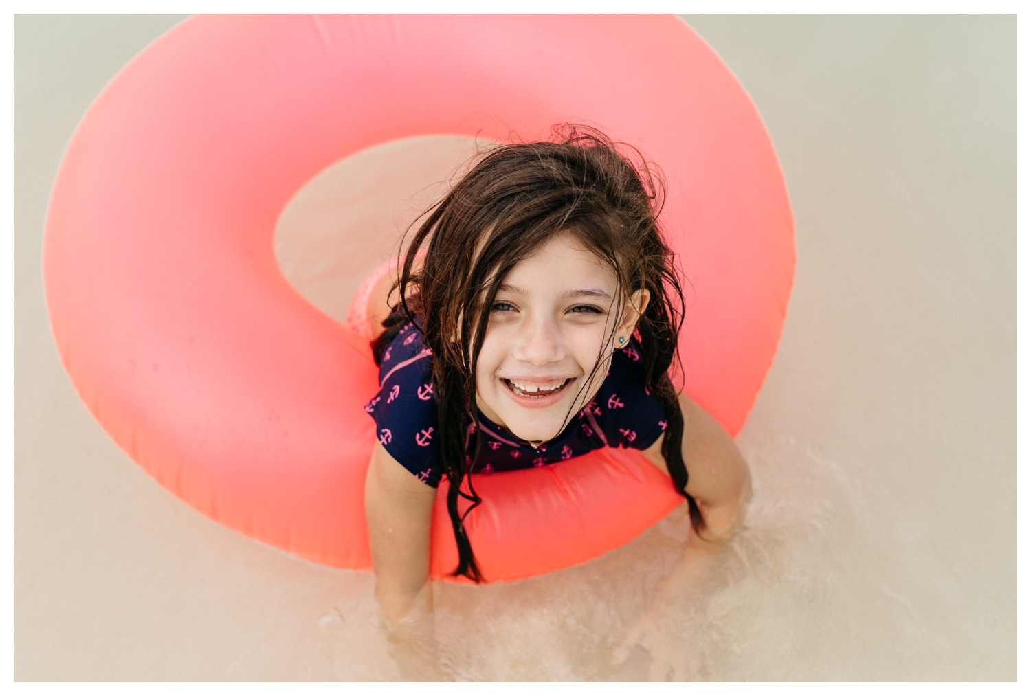 Girl in Pink Float in the Ocean Orlando Family Photographer.jpg