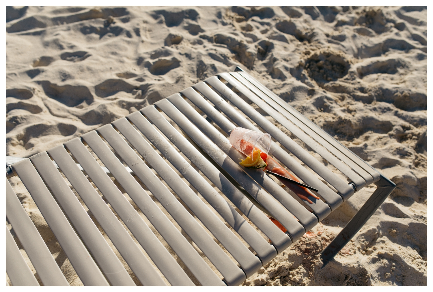 Spilled Cocktail on Beach Chair Hilton Aruba.jpg