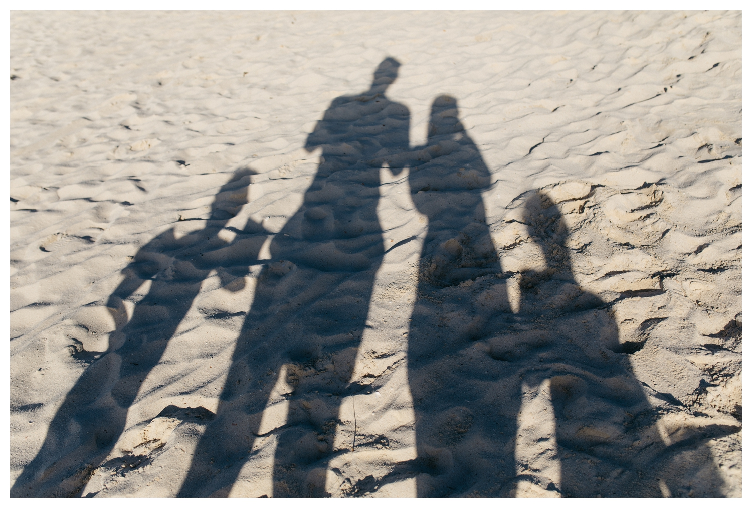 Orlando Family Shadow Portrait in Aruba Sand.jpg