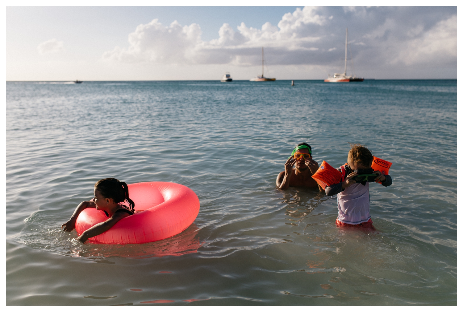 Father and His Children in Aruba Ocean at Sunset Orlando Documentary Photographer.jpg