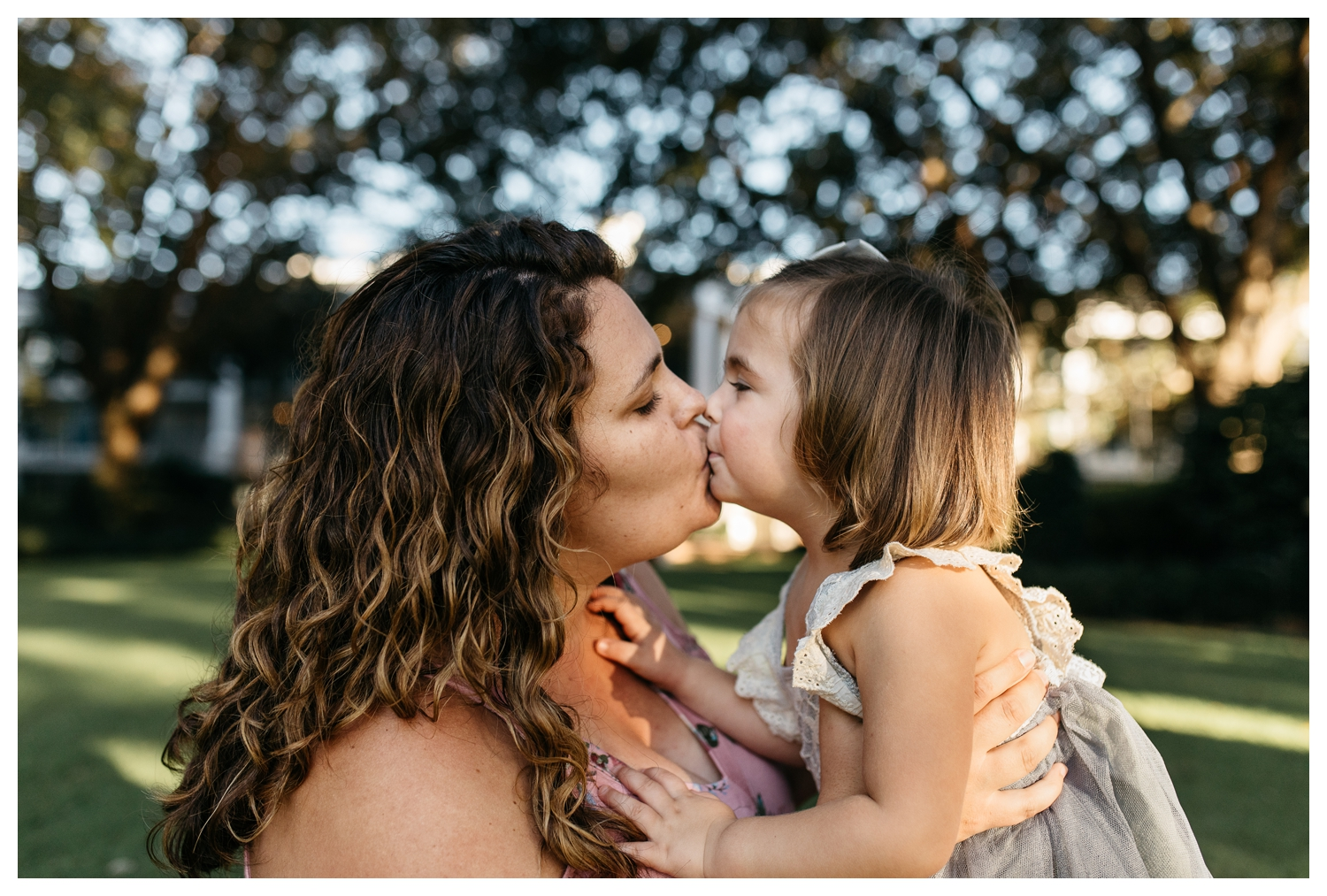 Mom and Daughter Share a Kiss Orlando Family Session.jpg