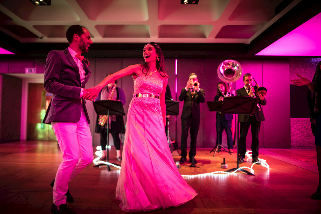 bride-and-groom-smiling-whilst-dancing-to-brassjunkies-brass-band-wedding.jpg