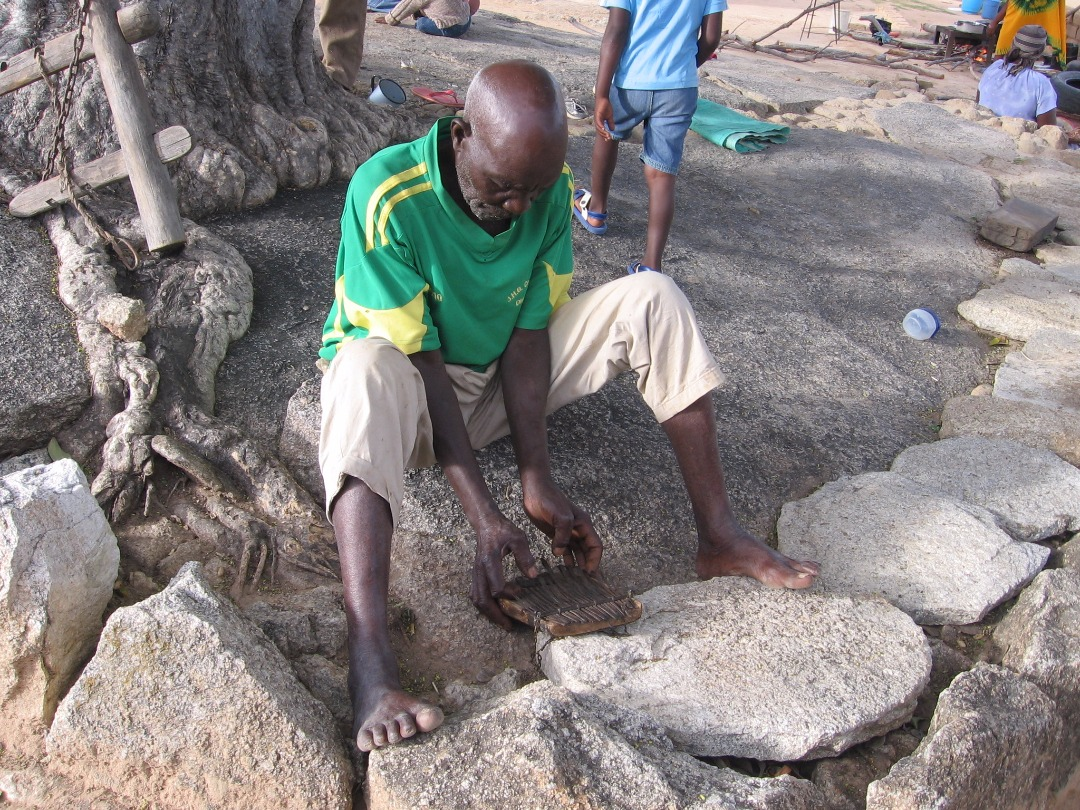 Partson Nyaruwabvu catches up on his playing with the repaired madhebhe.