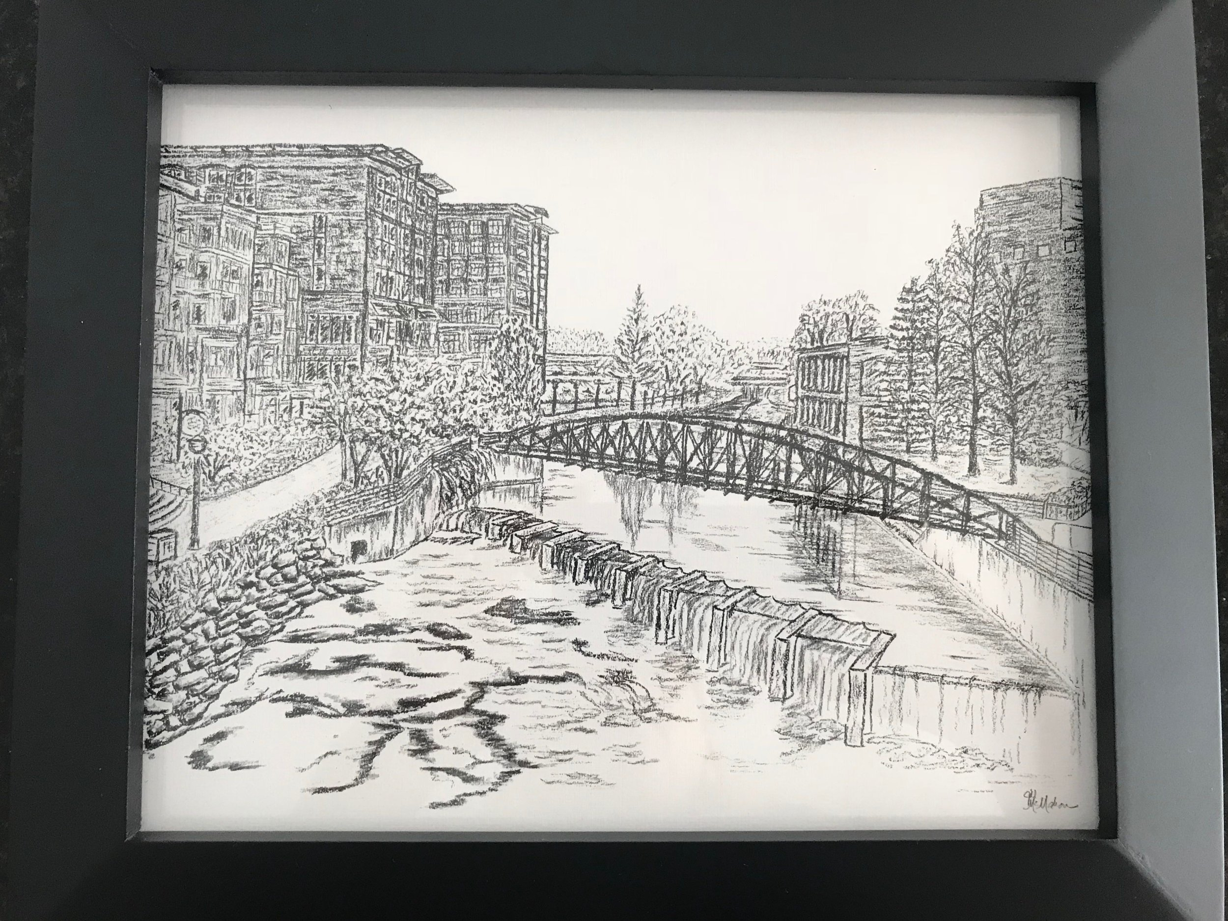REEDY RIVER CHARCOAL PRINT   Decorate your home with this framed 8x10 print of a charcoal drawing of the iconic Greenville landmark - Reedy River.  DONOR: Jill McMahon VALUE: $60