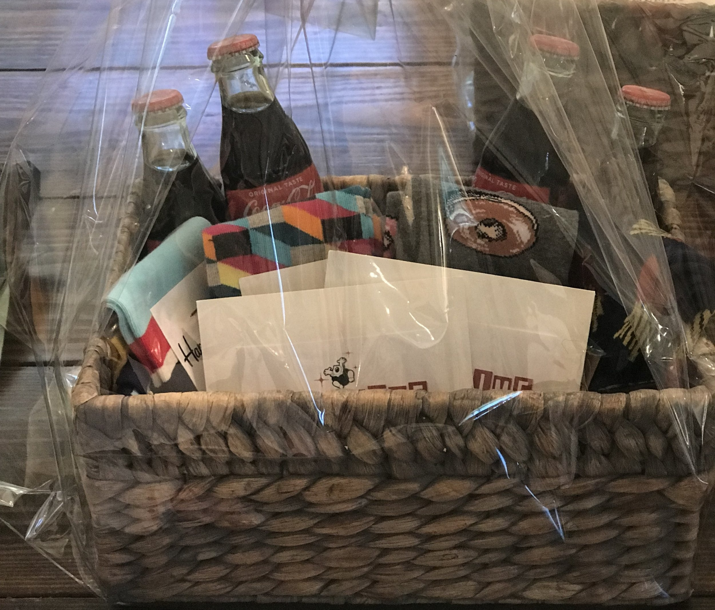 SPARE TIME BOWLING/MOVIE NIGHT BASKET   Get your GAME ON at Spare Time with the family. Included are $50 toward bowling and shoes, $30 toward Games, fun socks, Cokes and candy.  DONOR: 1st Grade Classes VALUE: $105