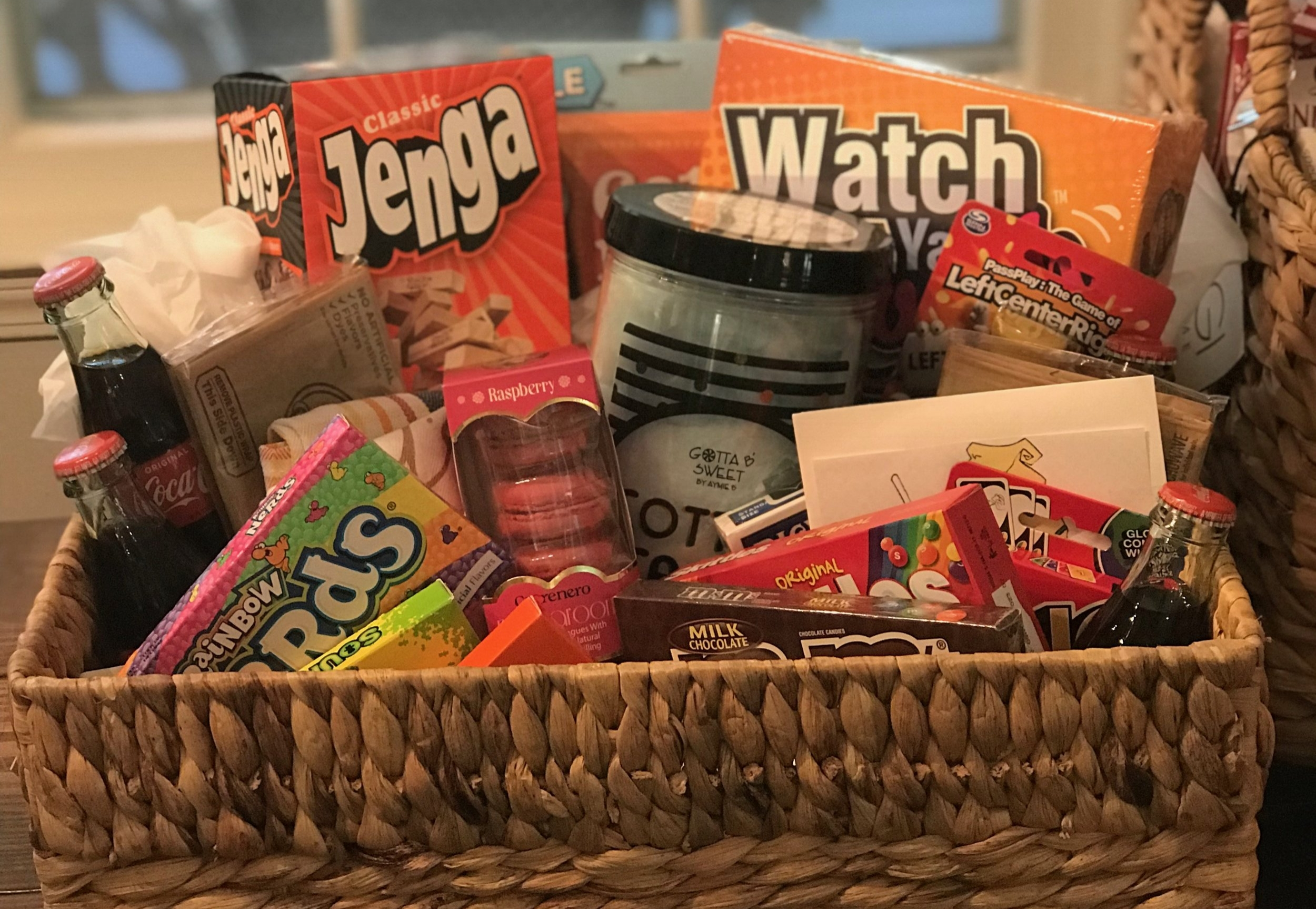 TAKEOUT, TREATS, GAMES AND MOVIE NIGHT BASKET   Stay in with the family and order out for a fun night of games and a movie. Included are $25 for takeout, Redbox gift card, Watch Ya Mouth, Jenga, 6-in-1 Cards, Left Right Center, Uno and a deck of cards, cotton candy, cookies, popcorn and other snacks.  DONOR: 1st Grade Classes VALUE: $125