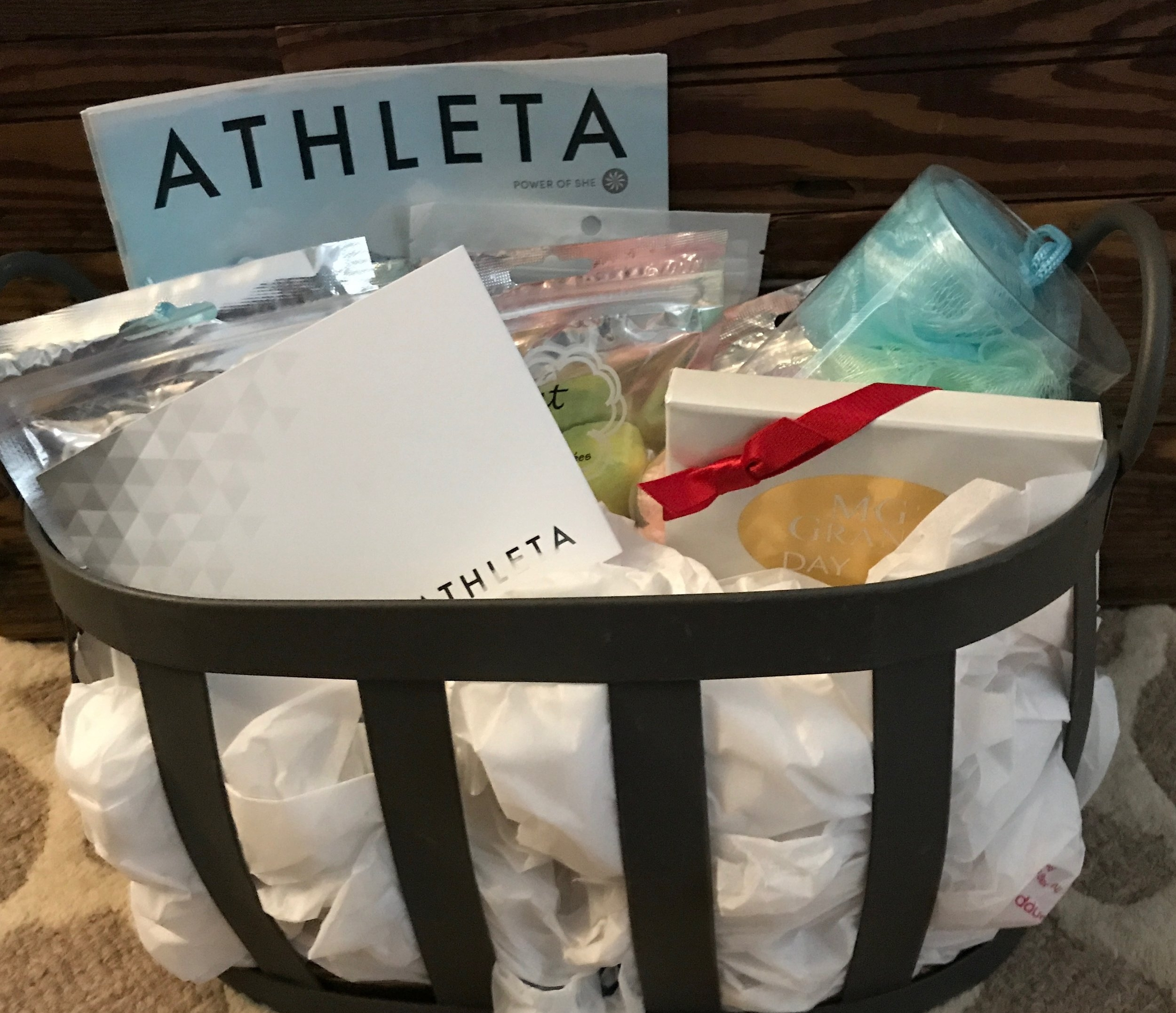 RELAXATION BASKET   Spoil yourself with a little retail therapy followed by a spa day! Included are $50 Athleta gift card, $50 MG GRAND Day Spa Gift card, and a few loofahs and bath bombs.  DONOR: 3rd Grade Classes VALUE: $105