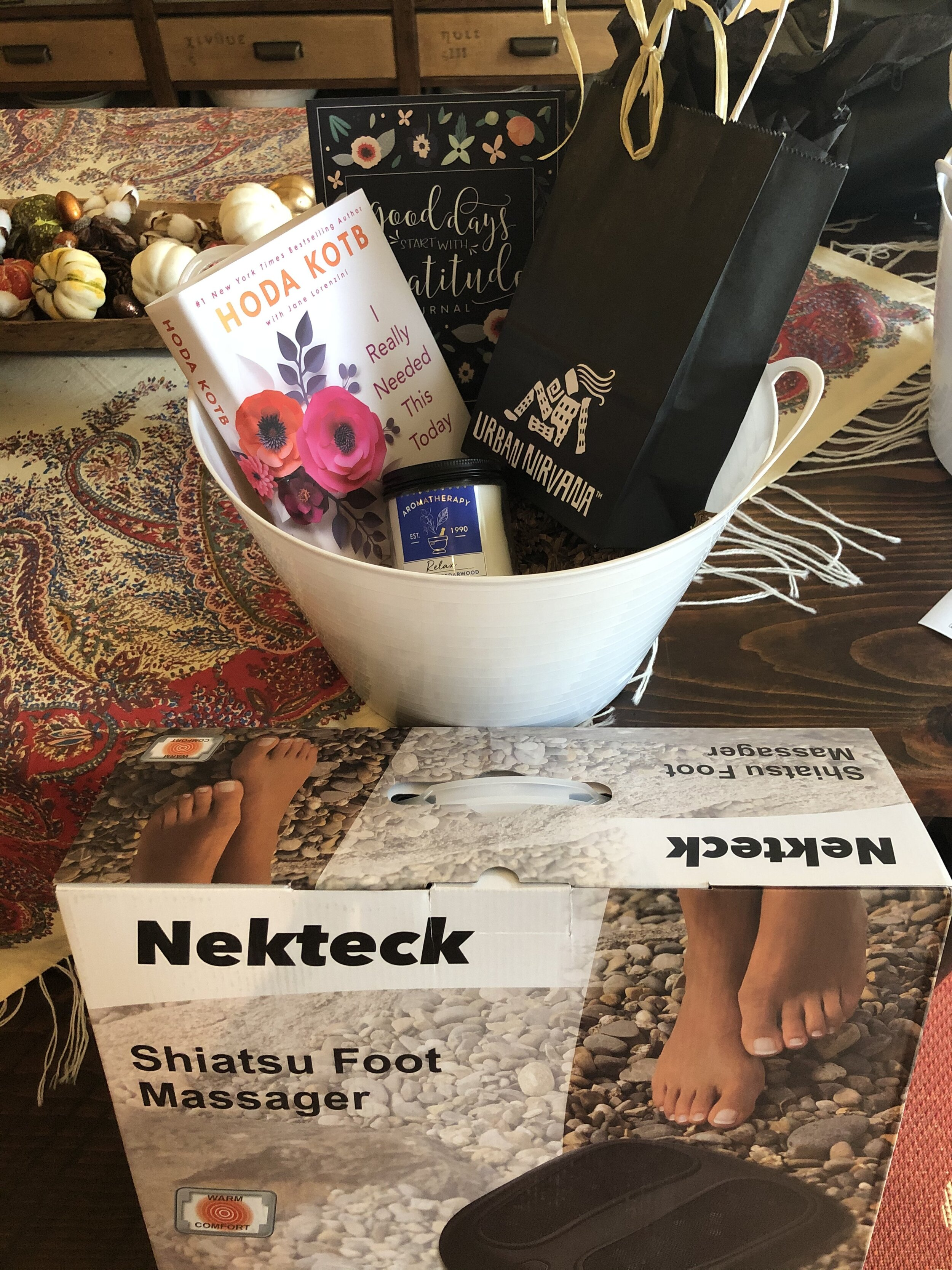 """""""I REALLY NEEDED THIS TODAY"""" SET   Remind yourself how important you are with this selfcare basket, including a $60 Express Facial from Urban Nirvana, Nekteck Shiatsu Foot Massager, Hoda Kotb's book  I Really Needed this Today , a gratitude journal and a lavender candle.  DONOR: 3rd Grade Classes VALUE: $147"""