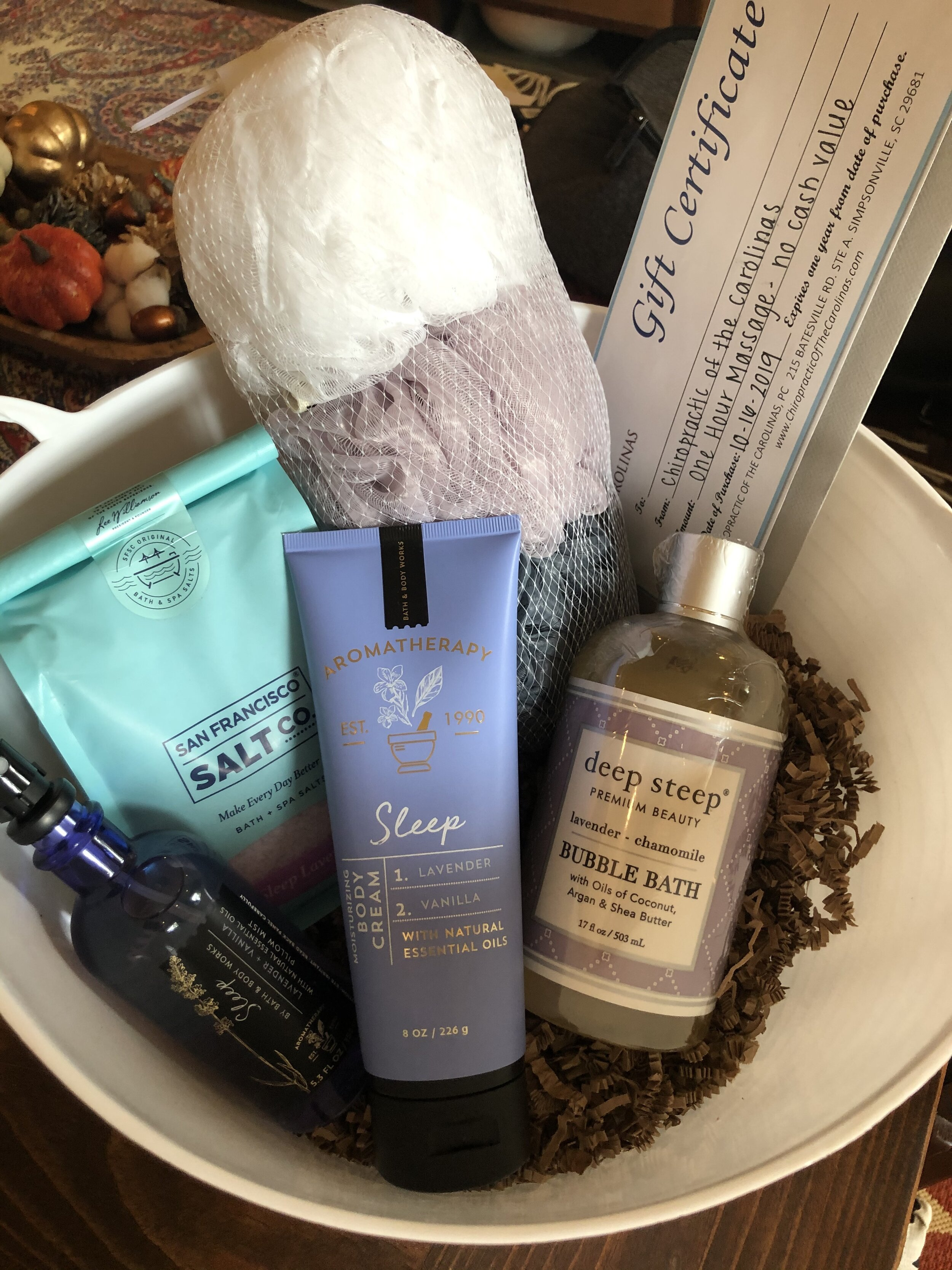 """""""I DESERVE THIS"""" SET   Take a break from all the stress in your life with this relaxation basket, including a 1-hour massage from Chiropractics of the Carolinas, bath salts, bubble bath, body cream, pillow mist and loofahs.  DONOR: 3rd Grade Classes VALUE: $147"""