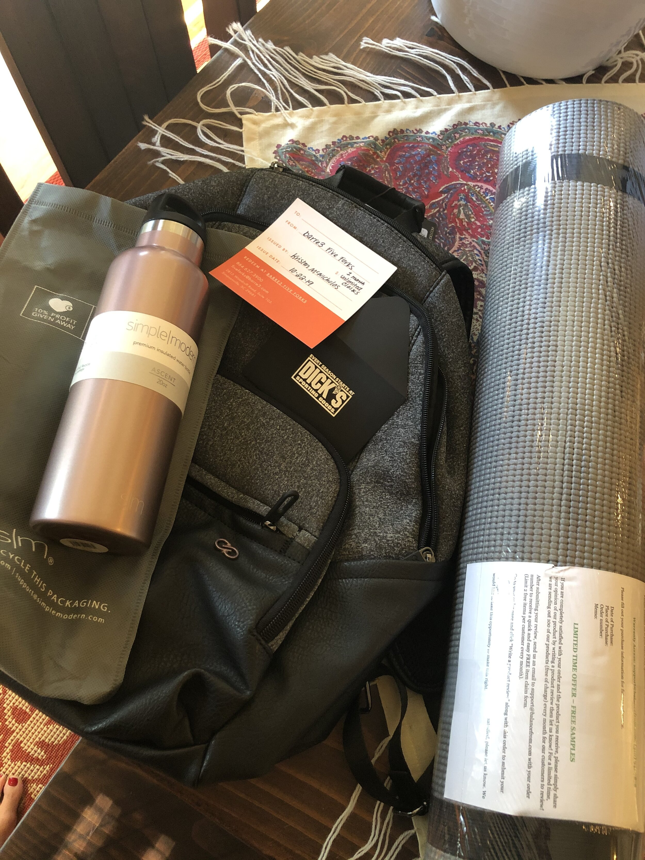 """""""I AM UNSTOPPABLE"""" SET   Strengthen your mind, body and spirit with this fitness backpack set. This Calia by Carrie Underwood Everyday backpack includes (1) month unlimited classes from Barre3, Dick's $25 Gift Card, water bottle, and yoga mat with strap.  DONOR: 3rd Grade Classes VALUE: $216"""