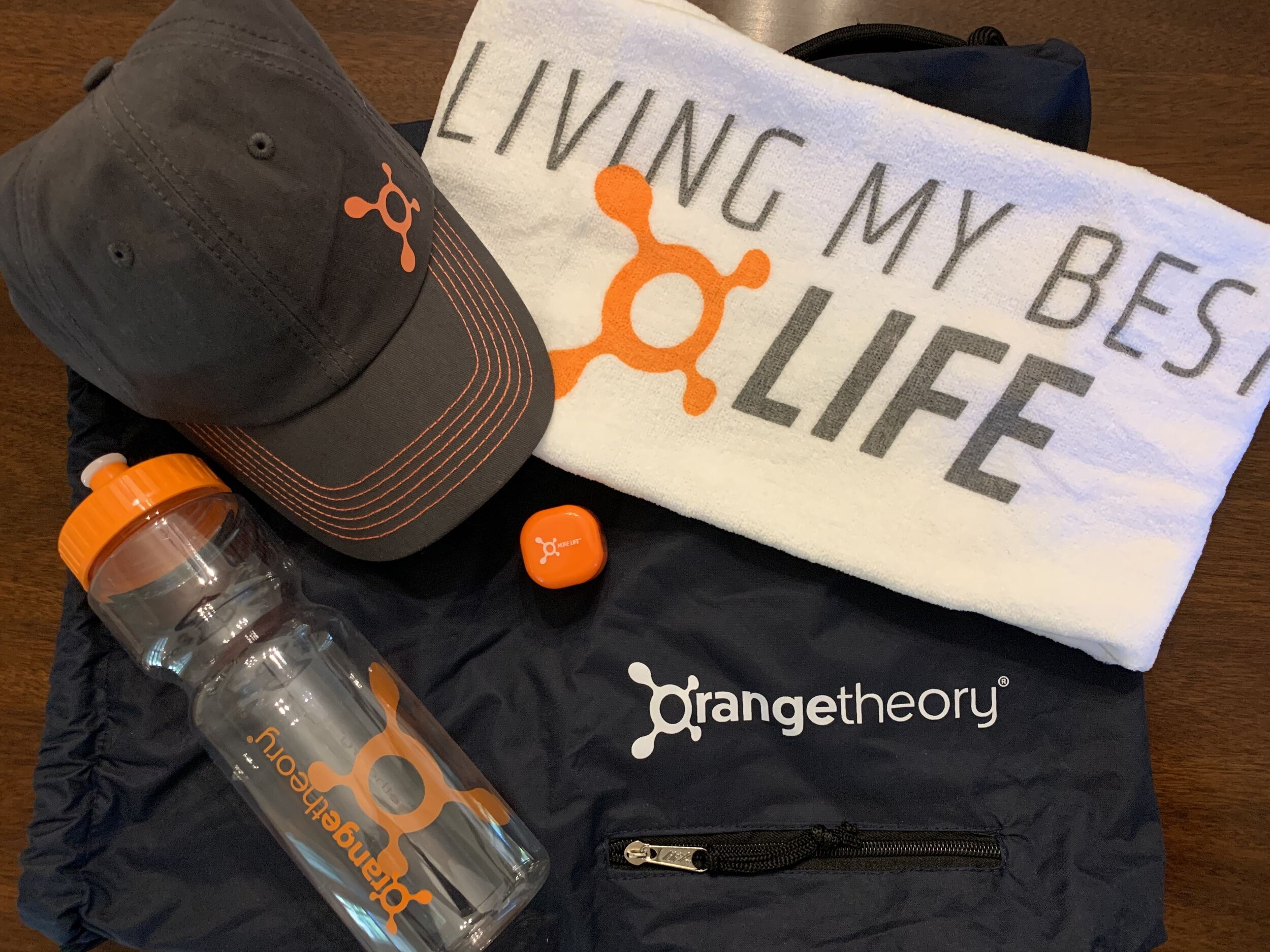ORANGETHEORY GIFT BAG   Orangetheory's fitness instructors provide inspiration and guidance through your workout and bring results based on your needs. Try it out with this 3-pack voucher good for a total of 3 workouts at the same studio, workout towel, hat and water bottle all in a drawstring bag.  DONOR: Orangetheory Greer VALUE: $125