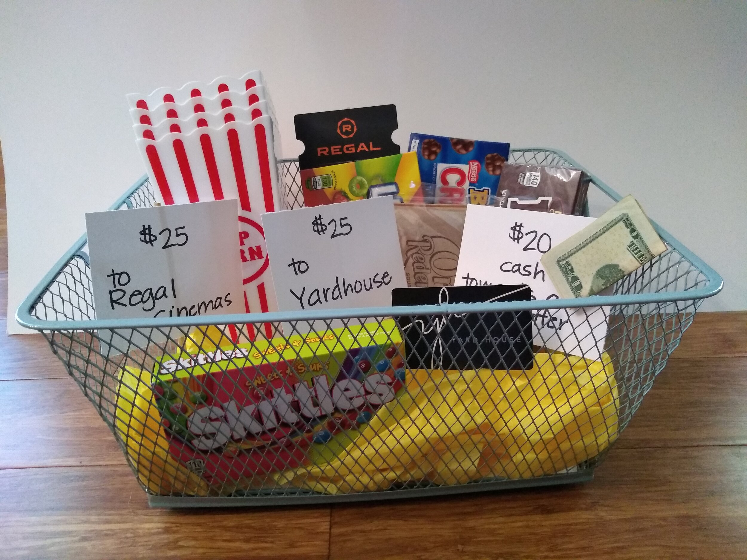 MOVIE NIGHT OUT   This basket is sure to please the parents and the kids! Parents - you can start your night off with drinks and dinner at Yard House. Walk over to Regal Cinemas and check out the latest and greatest movie that can't be beat on the big screen. And while you do that, your kids can enjoy their own movie night at home with a babysitter. We've got popcorn and candy for them - and even $20 towards the sitter!  DONOR: 5th Grade Classes VALUE: $84