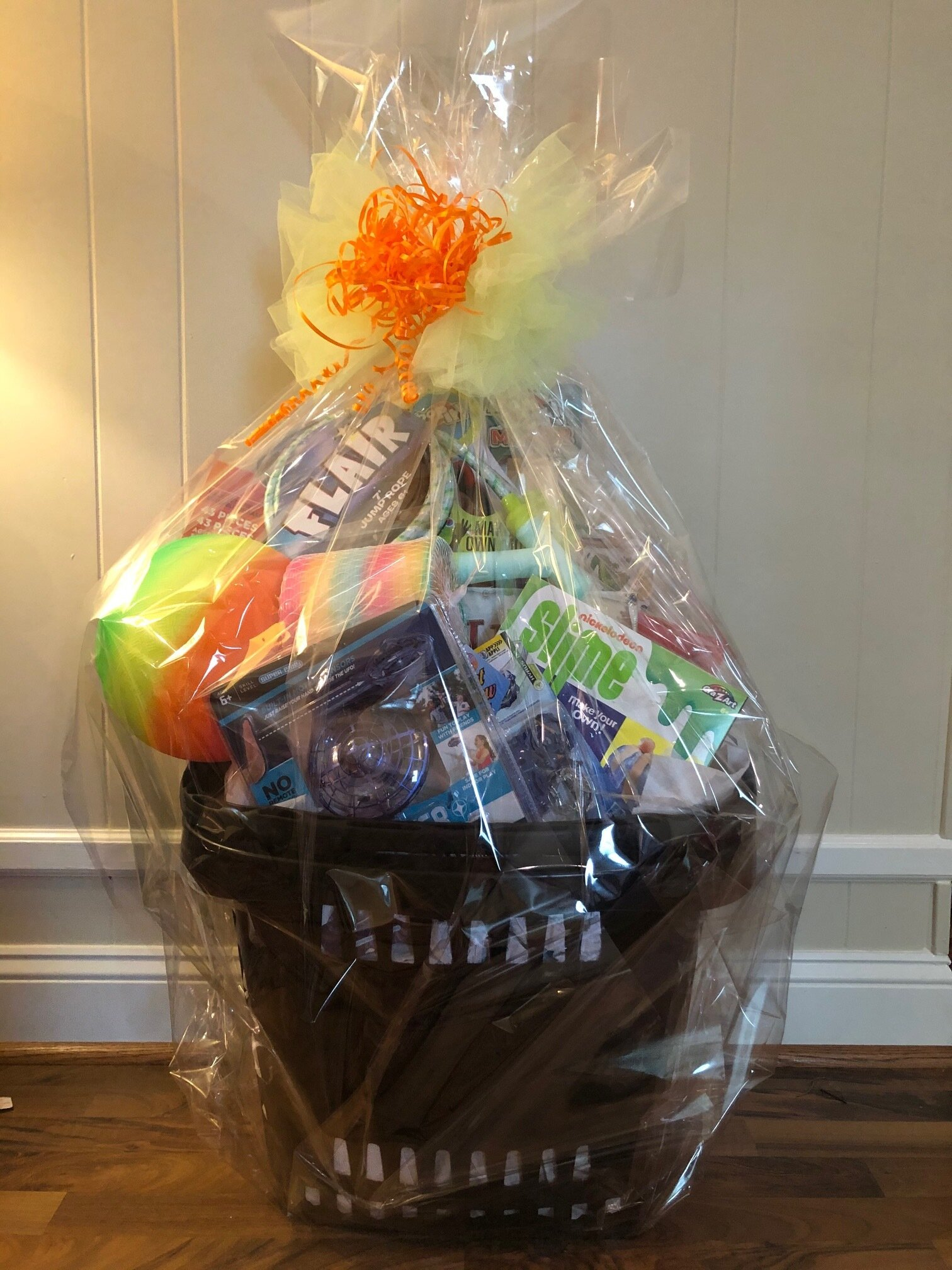 GENERAL TOY BASKET   Toys for everyone! This multi-purpose rolling basket includes a large box of Magformers, Hover Star drone, Galactic Slime, Bop-it, giant Slinky, Beyblade, stickers, bouncy ball, jump rope, and Ticket to Ride game.  DONOR: Kindergarten Classes VALUE: $134